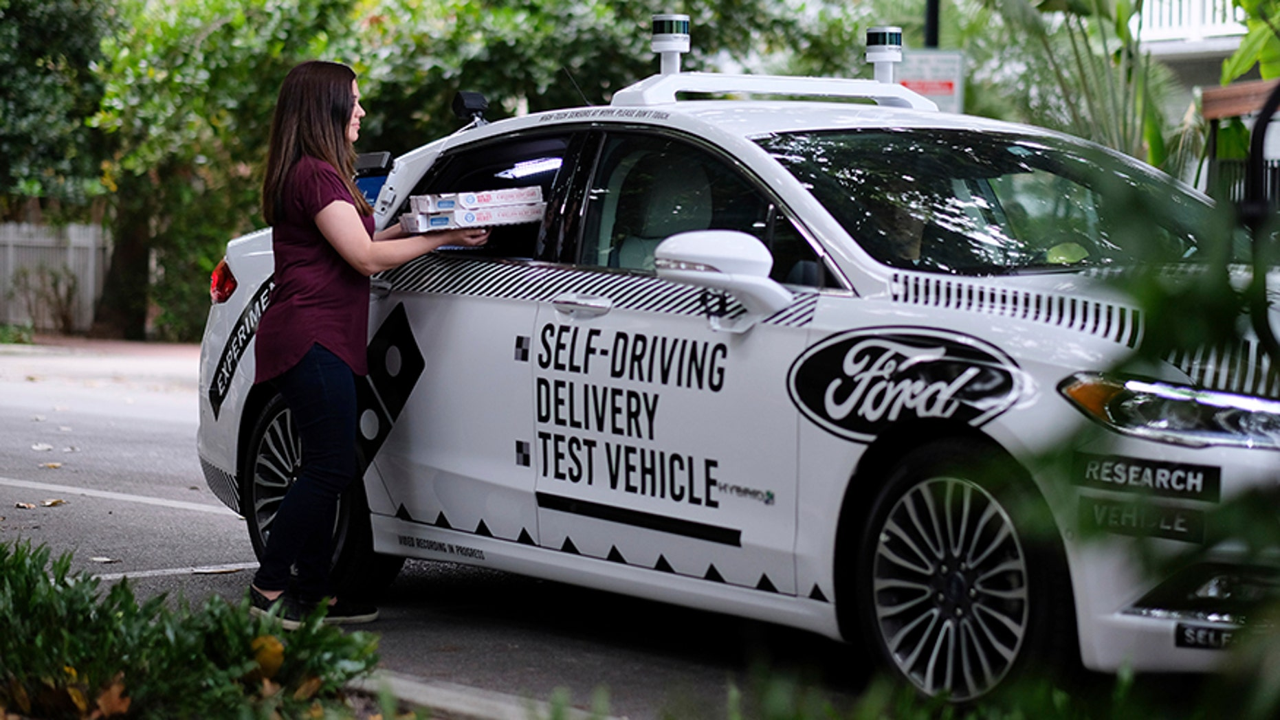 This undated image provided by Ford Motor Co. shows a self-driving vehicle from Ford and partner Domino's Pizza in Miami, Fla. Ford is making Miami-Dade County its new test bed for self-driving vehicles. Ford and its partners, including Domino's Pizza and ride-hailing company Lyft — are starting pilot programs now to see how consumers react to autonomous vehicles. (Ford Motor Co. via AP)