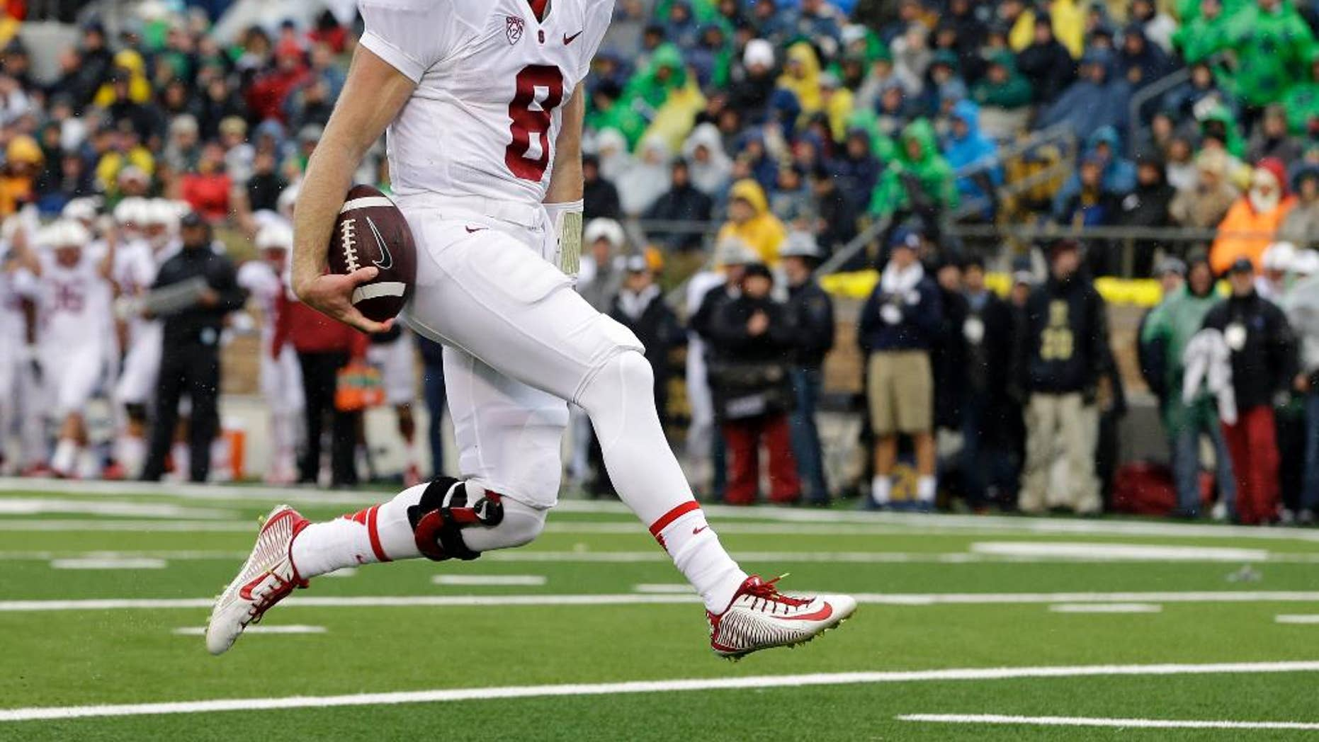Stanford quarterback Kevin Hogan (8) reacts after scoring on a 10-yard touchdown run during the first half of an NCAA college football game against Notre Dame, Saturday, Oct. 4, 2014, in South Bend, Ind. (AP Photo/Darron Cummings)