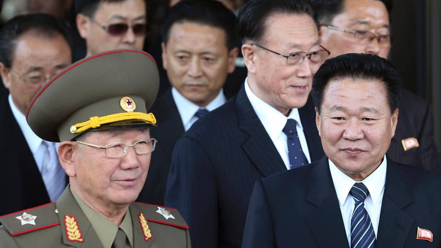 In this Saturday, Oct. 4, 2014 file photo, North Korea's National Defense Commission Vice Chairman Hwang Pyong So, left, and North Korea's ruling Workers Party Secretaries, Choe Ryong Hae, right, and Kim Yang Gon, center right, leave after a meeting with South Korean officials at a hotel in Incheon, South Korea. North Korea leader Kim Jong Un will soon send a special envoy to Russia, Pyongyang's state media reported Friday, in a trip expected to focus on how to boost ties at a time when Pyongyang faces deepening diplomat isolation. The North's Korean Central News Agency made the announcement about Choe 's planned trip but it did not give the timing or the exact purpose of the trip. (AP Photo/Yonhap, Yun Tae-hyun, File) KOREA OUT