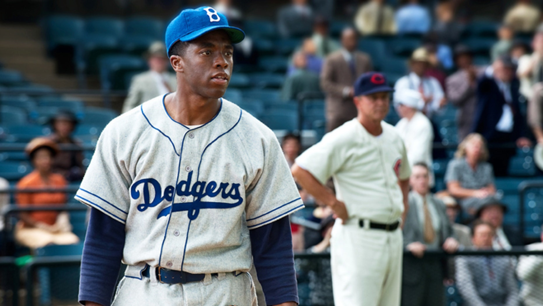 "This film image released by Warner Bros. Pictures shows Chadwick Boseman as Jackie Robinson in a scene from ""42."""