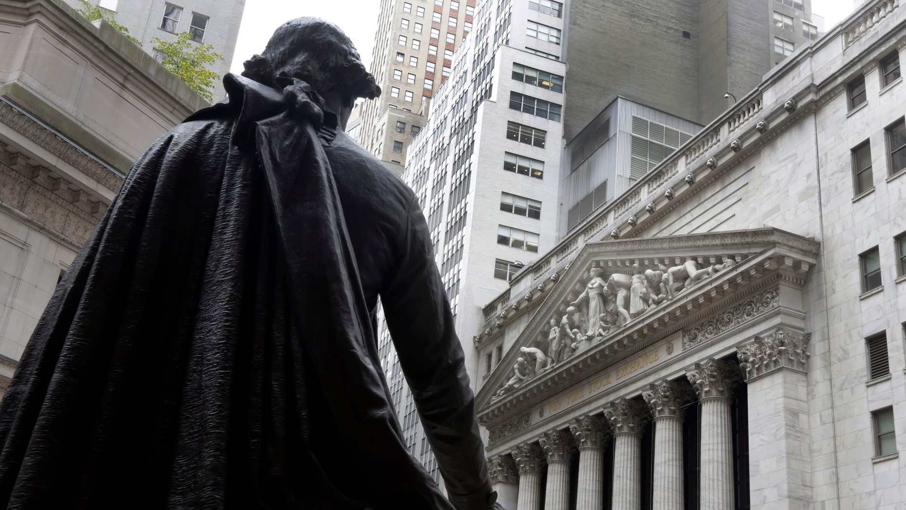 FILE - In this Oct. 2, 2014, file photo, the statue of George Washington on the steps of Federal Hall faces the facade of the New York Stock Exchange. U.S. employers added a vigorous 257,000 jobs in January, and wages jumped by the most in six years, evidence that the job market is accelerating closer to full health. The surprisingly robust report the government issued Friday, Feb. 6, 2015 also showed that hiring was far stronger in November and December than it had previously estimated.  .(AP Photo/Richard Drew, File)