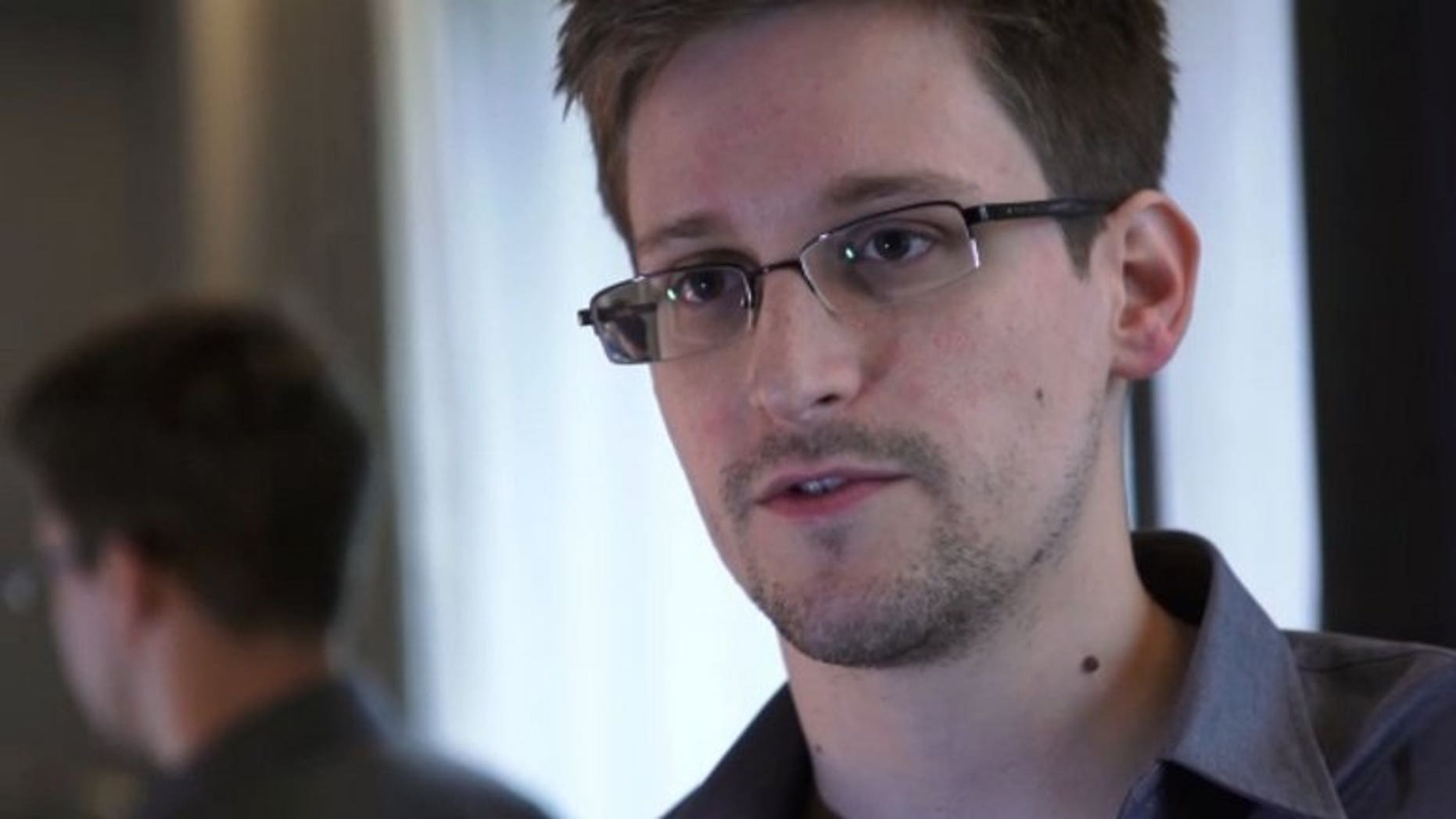 Edward Snowden speaks during an interview with The Guardian newspaper at an undisclosed location in Hong Kong on June 6, 2013. US intelligence leaker Edward Snowden has applied to another six countries for asylum, WikiLeaks said on its Twitter feed.
