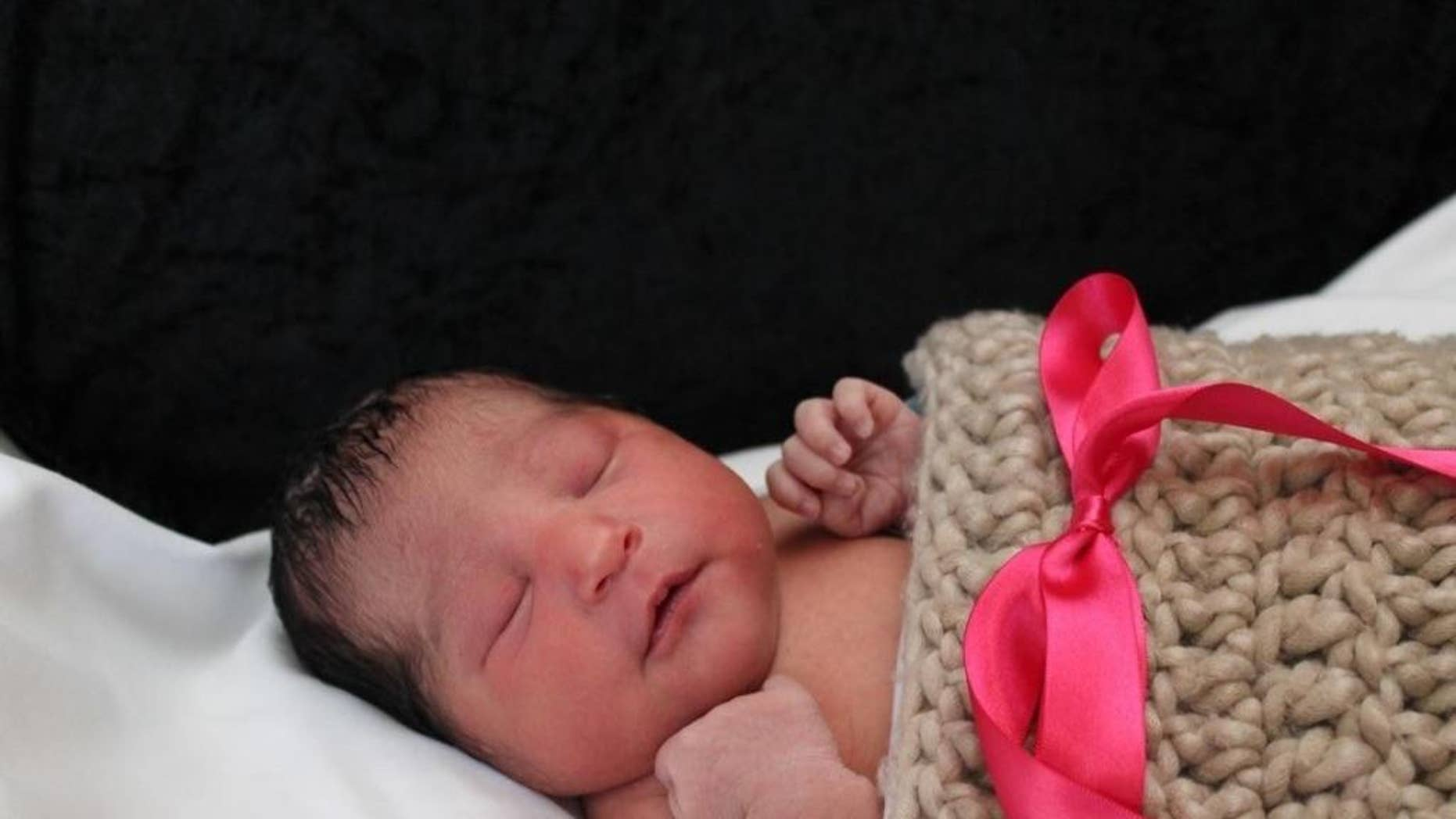 """This photo provided by the Wichita Police shows Sofia Victoria Gonzalez Abarca, a missing week-old baby in Wichita, Kan.   Authorities are searching for the missing week-old baby after her mother was found fatally shot in Wichita.  A relative found the woman dead Thursday, Nov. 17, 2016,  in her apartment. Sgt. Nikki Woodrow says the woman's daughter, Sofia Victoria Gonzalez Abarca, is """"considered missing and endangered.""""   (Wichita Police via AP)"""