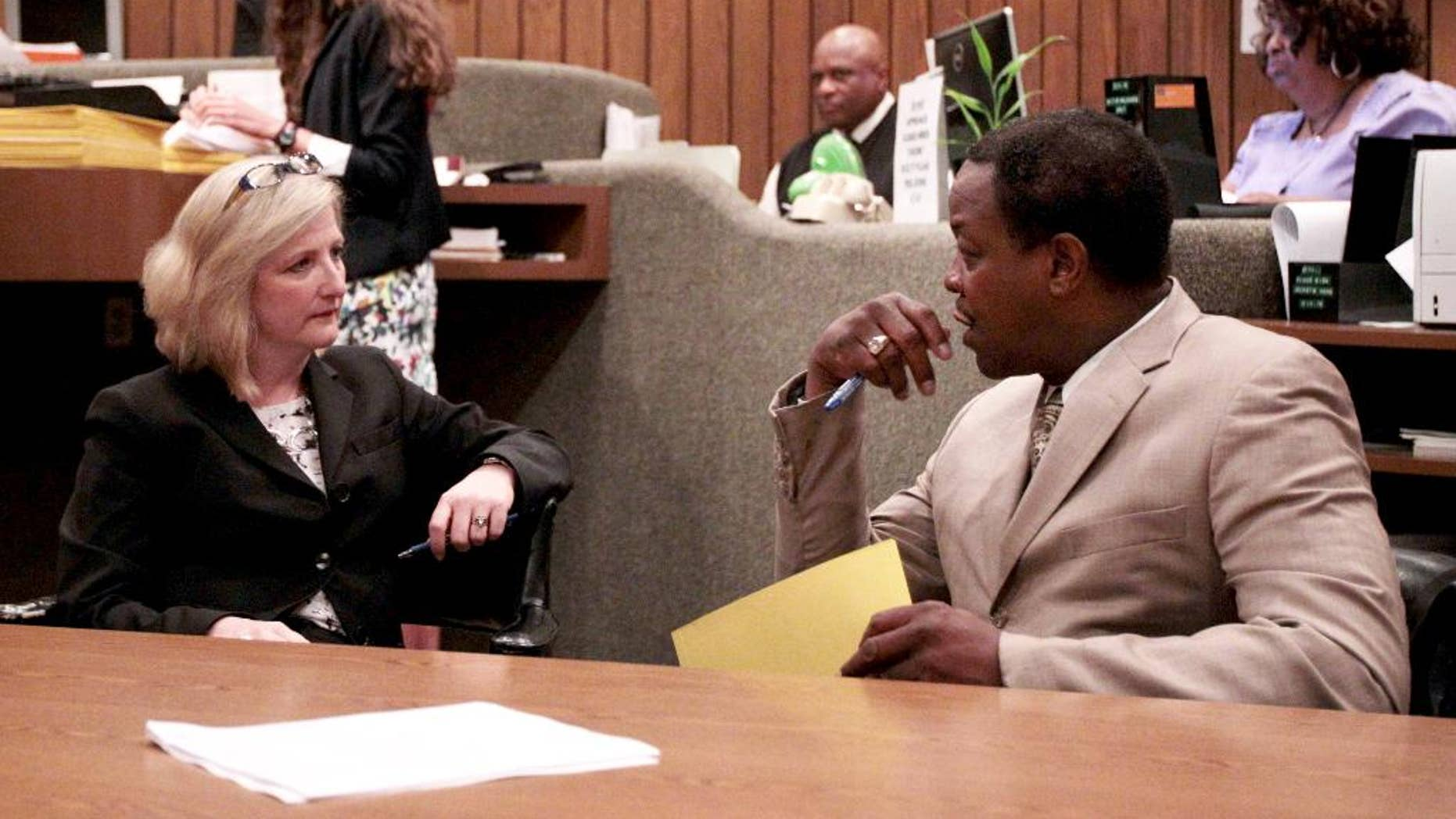 Prosecutors Alanda Dwyer, left, and Reginald Henderson talk before Judge Loyce Lambert Ryan's general session Court Division 15 is called to order as they await the video arraignment of Tremaine Wilbourn on charges of first degree murder for the death of Memphis Police officer Sean Bolton, Wednesday, Aug. 5, 2015, in Memphis. Wilbourn did not enter a plea on the charge of first-degree murder. (Mike Brown/The Commercial Appeal via AP)