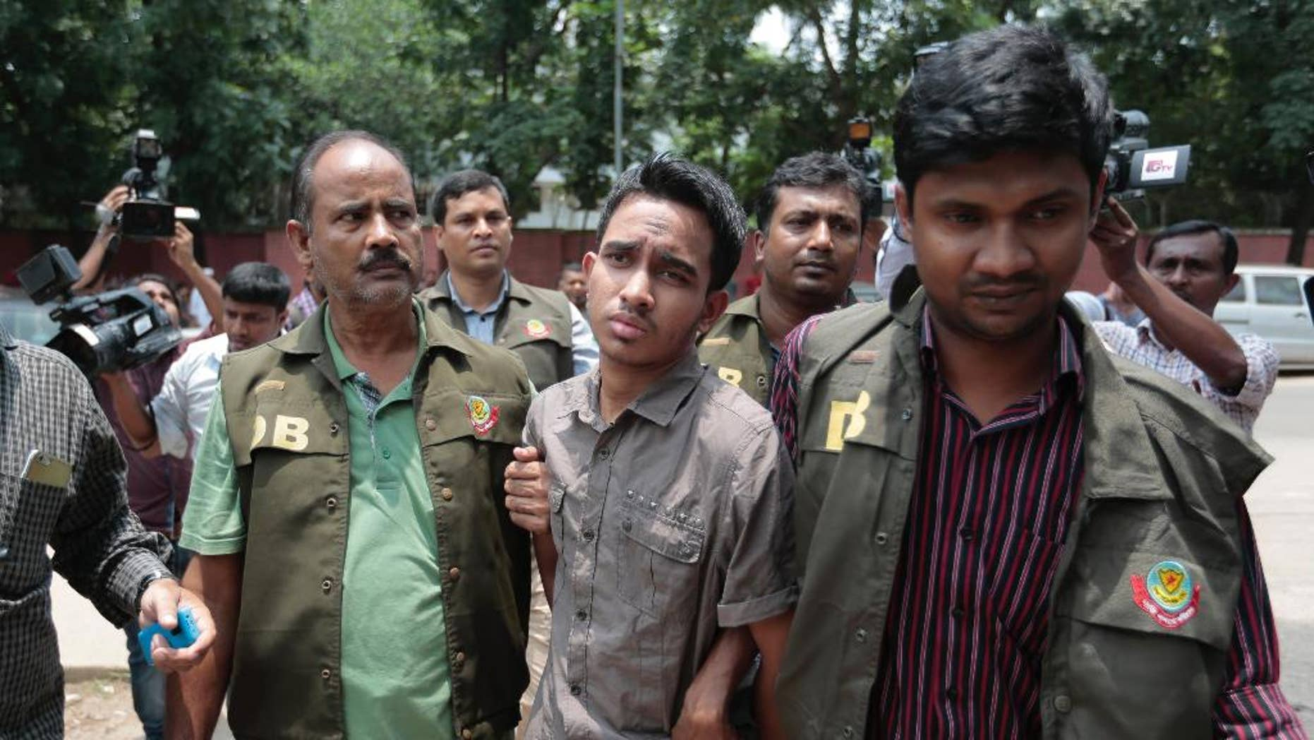 Members of Bangladesh Police Detective Branch escort Mohammed Sumon Hossain in Dhaka, Bangladesh, Thursday, June 16, 2016. Police counter-terrorism chief Monirul Islam told reporters that Hossain is charged with taking part in the October attack on publisher Ahmed Rashid Tutul who worked on books by a prominent atheist writer who was killed in a separate attack. (AP Photo)