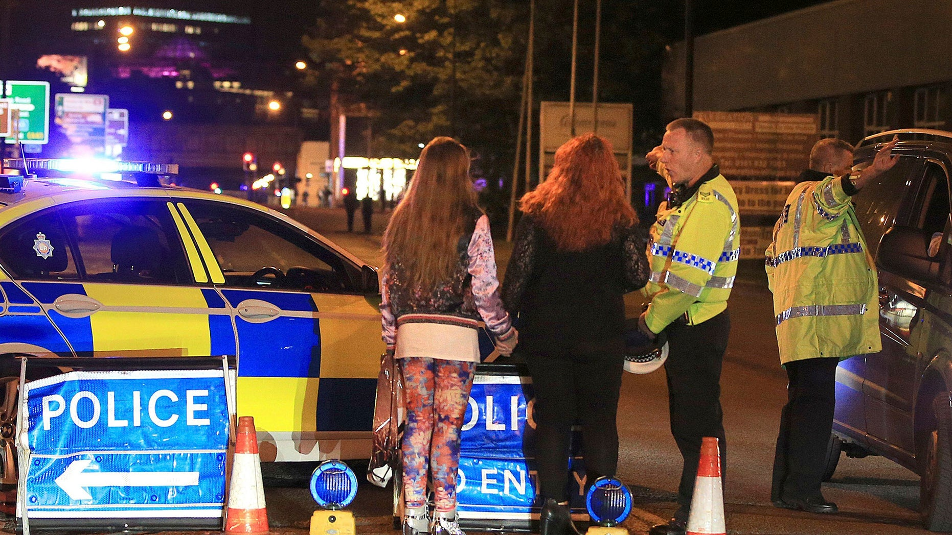 Police work at Manchester Arena after reports of an explosion at the venue during an Ariana Grande gig in Manchester, England Monday, May 22, 2017. Several people have died following reports of an explosion Monday night at an Ariana Grande concert in northern England, police said. A representative said the singer was not injured. (Peter Byrne/PA via AP)