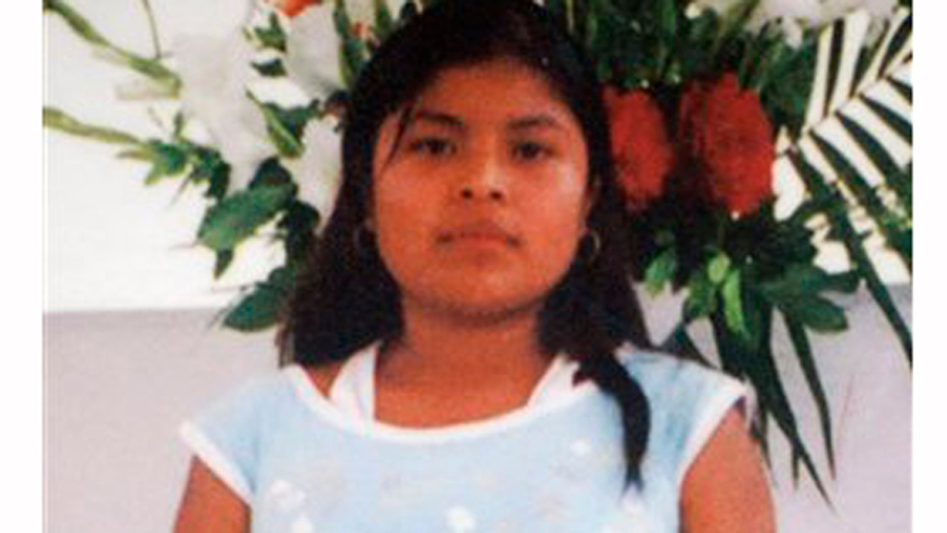 """Maria Isavel Vasquez Jimenez, a farmworker who died in 2008 after working for nine hours in a California vineyard without shade or water in near-100-degree temperature. Her family pleaded with Brown to pass a bill that would help farmworkers. """"We don't want another family to suffer like ours,"""" said Maria's uncle, Doroteo Jimenez."""