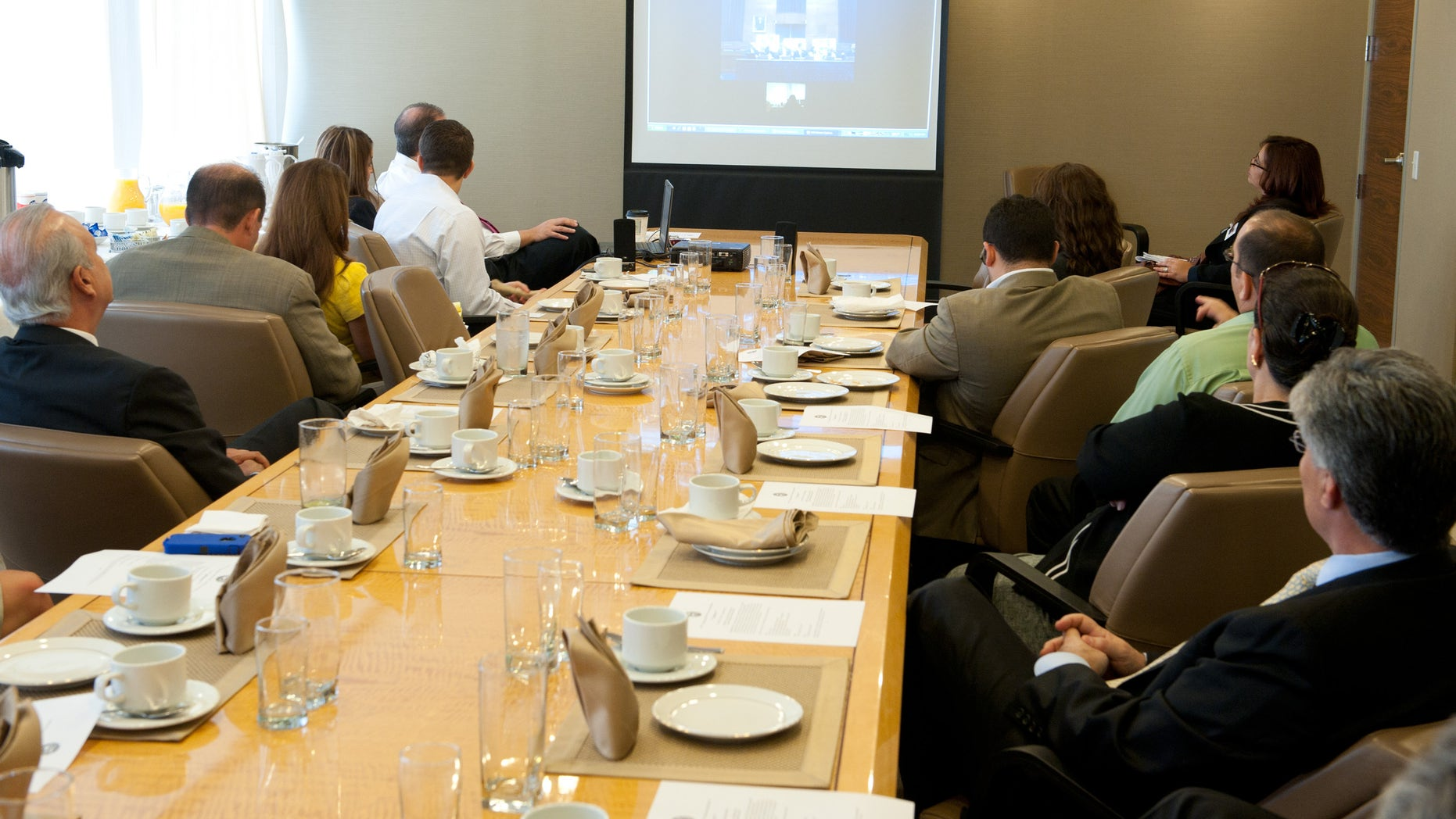 Members of the Cuban American Bar Association in Miami listen via Skype to a briefing in Washington D.C. on human rights violations in Cuba.