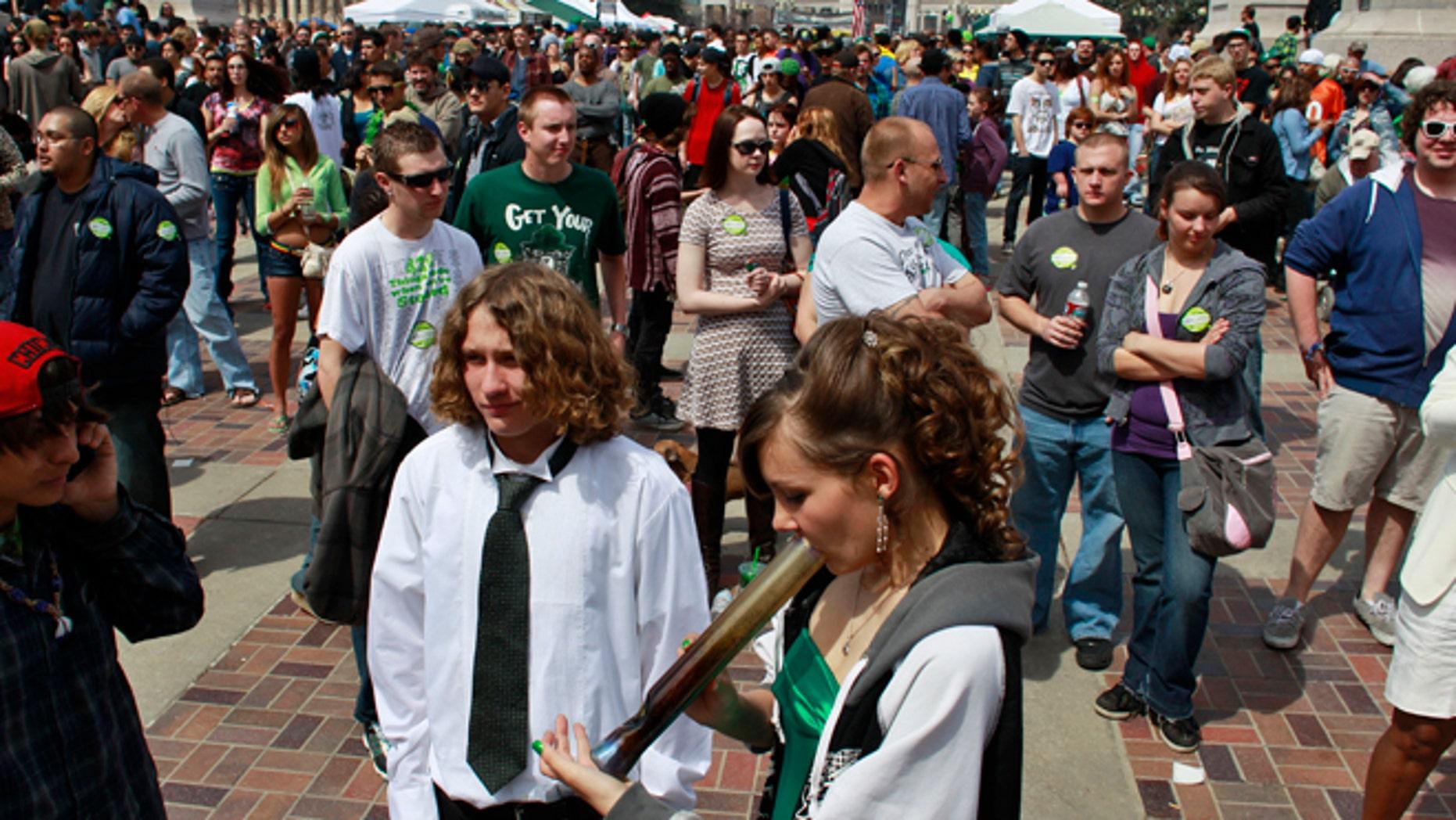 April 20, 2013: Youths smoke marijuana at the Denver 4/20 pro-marijuana rally at Civic Center Park in Denver.