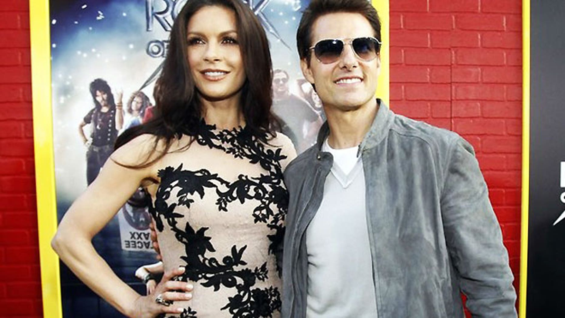 """June 8: Cast members Tom Cruise and Catherine Zeta-Jones pose at the premiere of """"Rock of Ages"""" at the Grauman's Chinese theatre in Hollywood, California."""