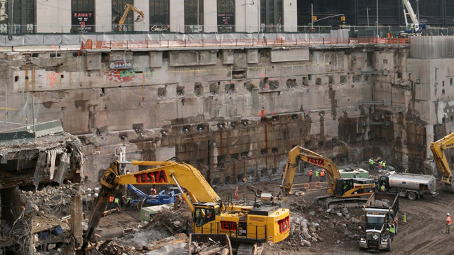 FILE - Construction workers and equipment excavate the southeastern corner of the World Trade Center site on in this Jan. 8, 2008 file photo taken in New York.