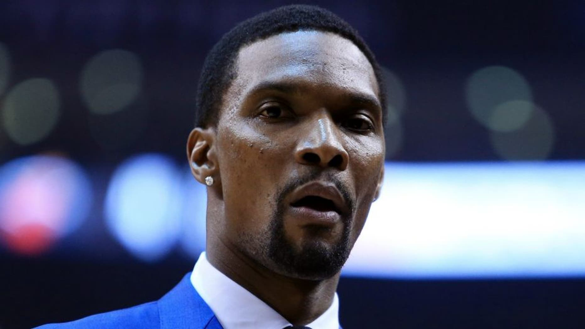 TORONTO, ON - MAY 03: Chris Bosh #1 of the Miami Heat looks on from the bench in the first half of Game One of the Eastern Conference Semifinals against the Toronto Raptors during the 2016 NBA Playoffs at the Air Canada Centre on May 3, 2016 in Toronto, Ontario, Canada. NOTE TO USER: User expressly acknowledges and agrees that, by downloading and or using this photograph, User is consenting to the terms and conditions of the Getty Images License Agreement. (Photo by Vaughn Ridley/Getty Images)