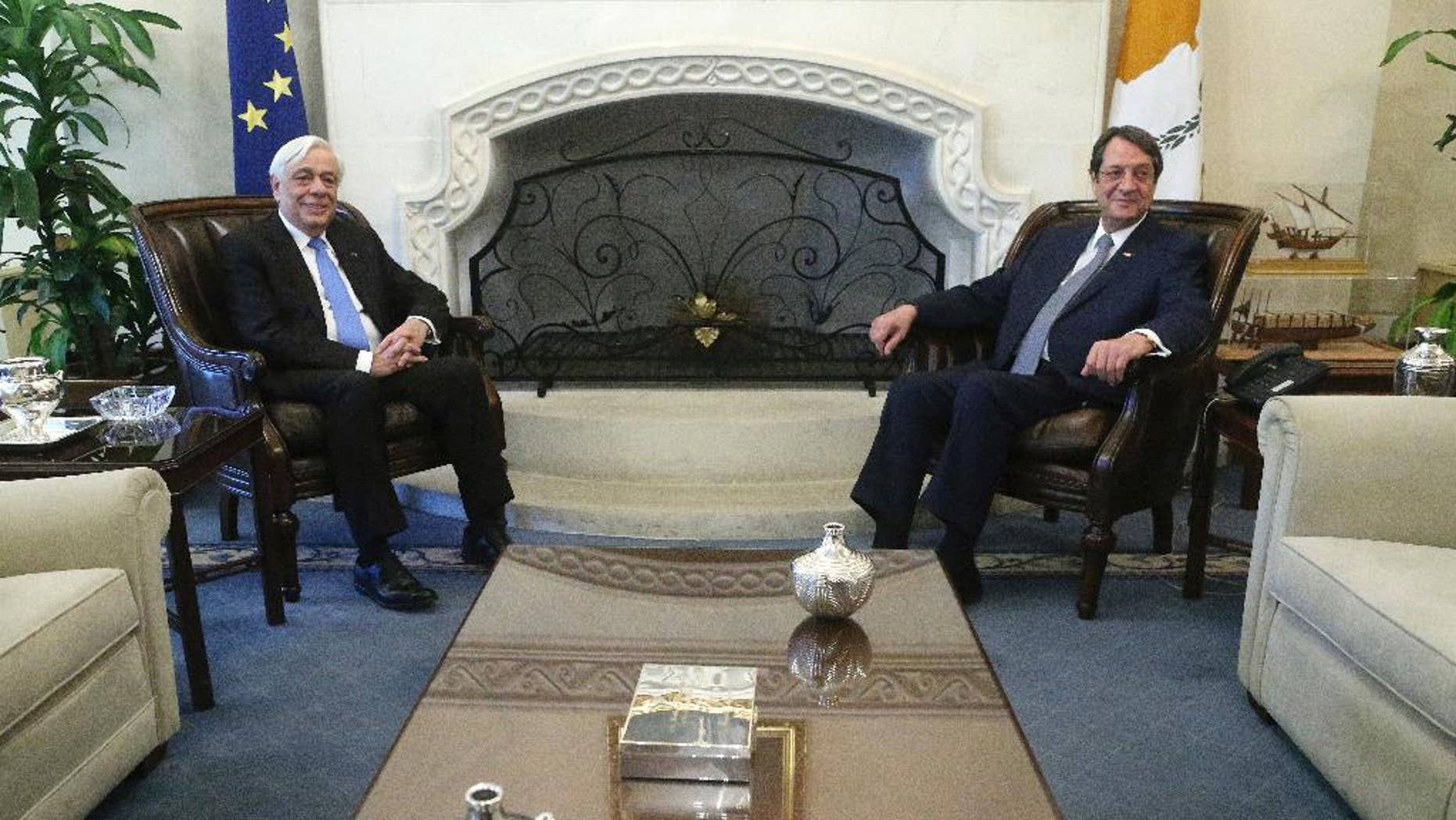 Cypriot President Nikos Anastasiades, right, and Greek President Prokopis Pavlopoulos pose for photographers prior to their meeting at the presidential palace in Nicosia in the eastern Mediterranean island of Cyprus, Thursday, Jan. 19, 2017. Pavlopoulos is in Cyprus for a one-day visit. (AP Photo/Petros Karadjias)