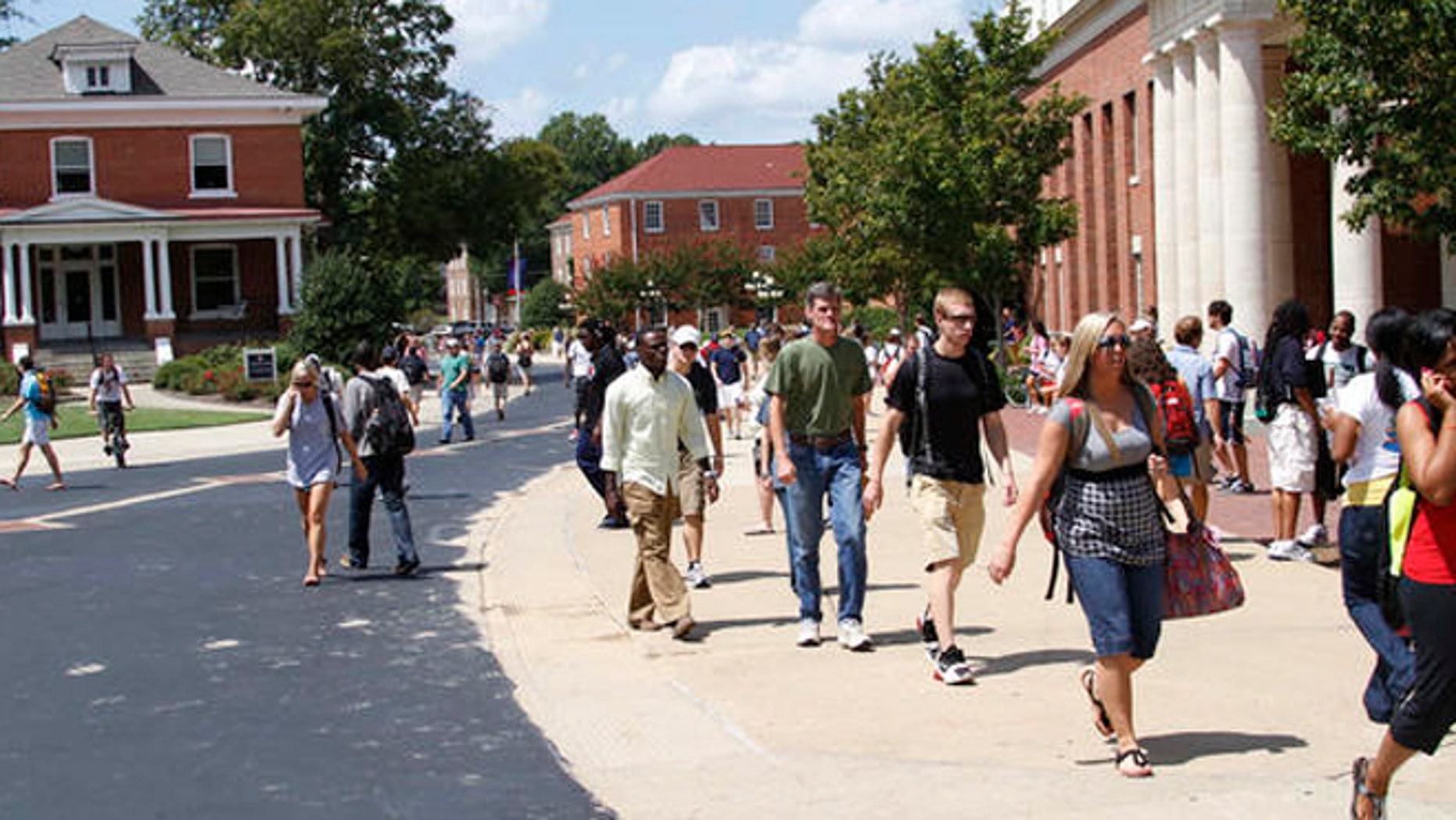 Students rush to class at the University of Mississippi, Sept. 1, 2010, in Oxford, Miss. Fiscal cuts from state funding are expected to affect all of the state's eight public colleges and may force faculty and staff layoffs, program eliminations and cuts in classes and services offered to students as well as raise various fees at the schools while they try to lessen the loss of funds.  (AP Photo/Rogelio V. Solis)