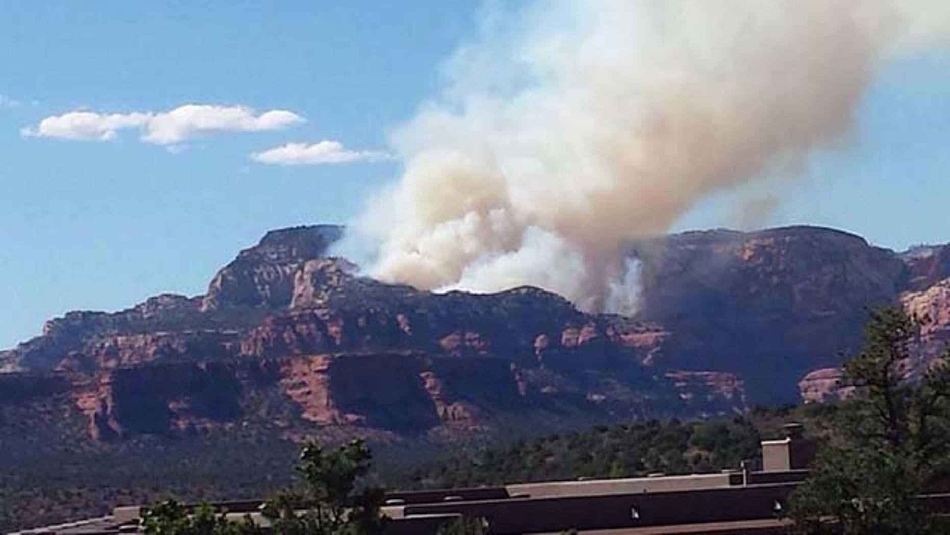 July 20, 2014: Smoke from a fire sparked by the crash of a single-engine plane rises over Fay Canyon, near Sedona, Arizona. (MyFoxPhoenix.com)