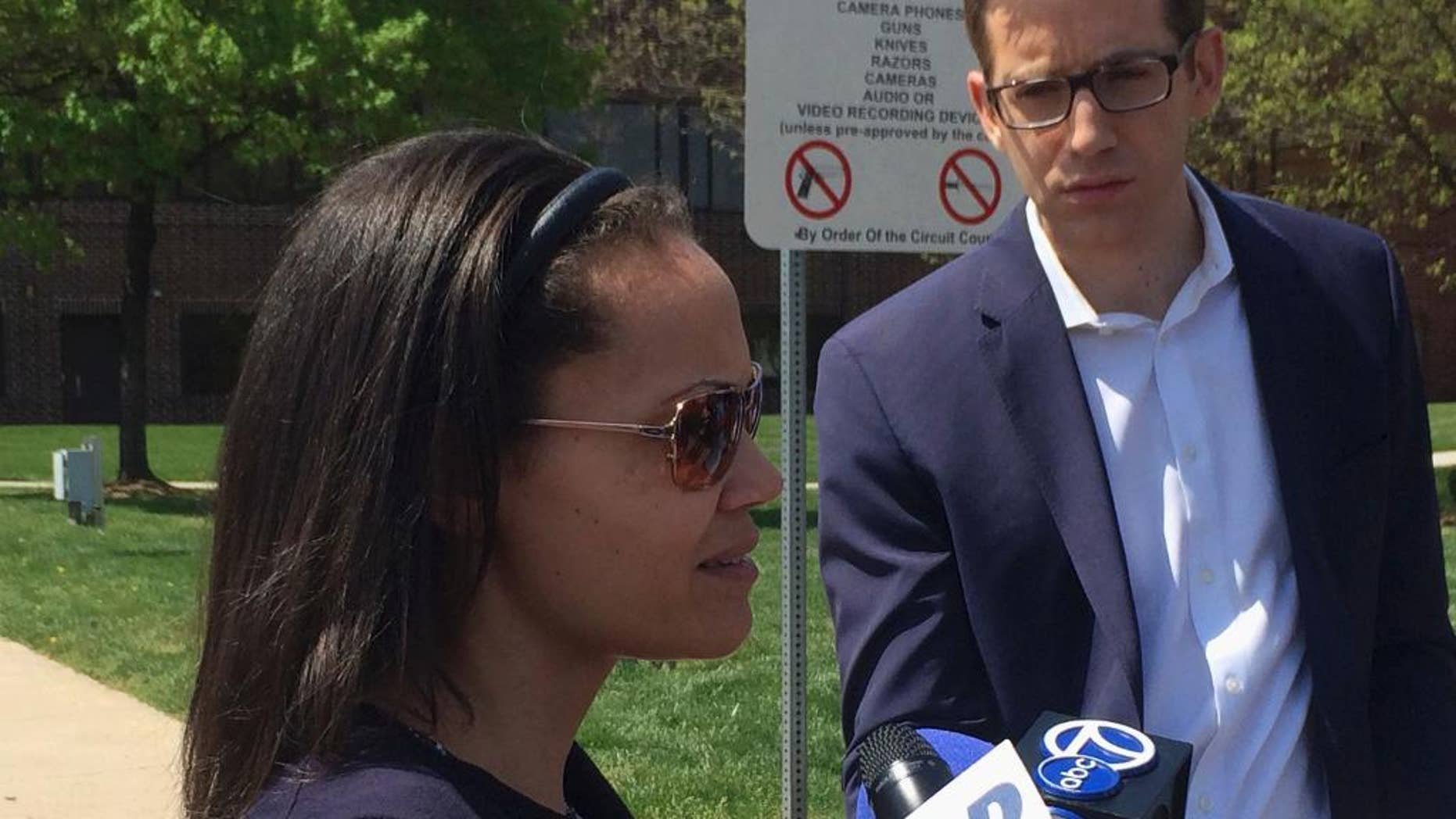 Hera McLeod talks to reporters in Manassas, Va., Thursday, April 13, 2017,  after her ex-fiancé, Joaquin Shadow Rams, was convicted of murdering their 1-year-old son. A judge has convicted a Virginia father of murdering his 1-year-old son in an effort to collect on more than $500,000 in life insurance he had taken out on the boy. (AP Photo/Matthew Barakat)