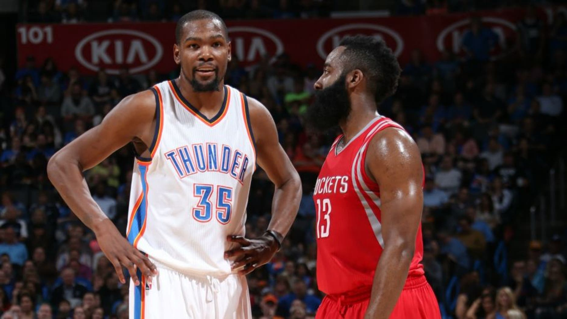 OKLAHOMA CITY, OK- JANUARY 29: Kevin Durant #35 of the Oklahoma City Thunder and James Harden #13 of the Houston Rockets talk during the game on January 29, 2016 at Chesapeake Energy Arena in Oklahoma City, Oklahoma. NOTE TO USER: User expressly acknowledges and agrees that, by downloading and or using this photograph, User is consenting to the terms and conditions of the Getty Images License Agreement. Mandatory Copyright Notice: Copyright 2016 NBAE (Photo by Layne Murdoch Jr./NBAE via Getty Images)