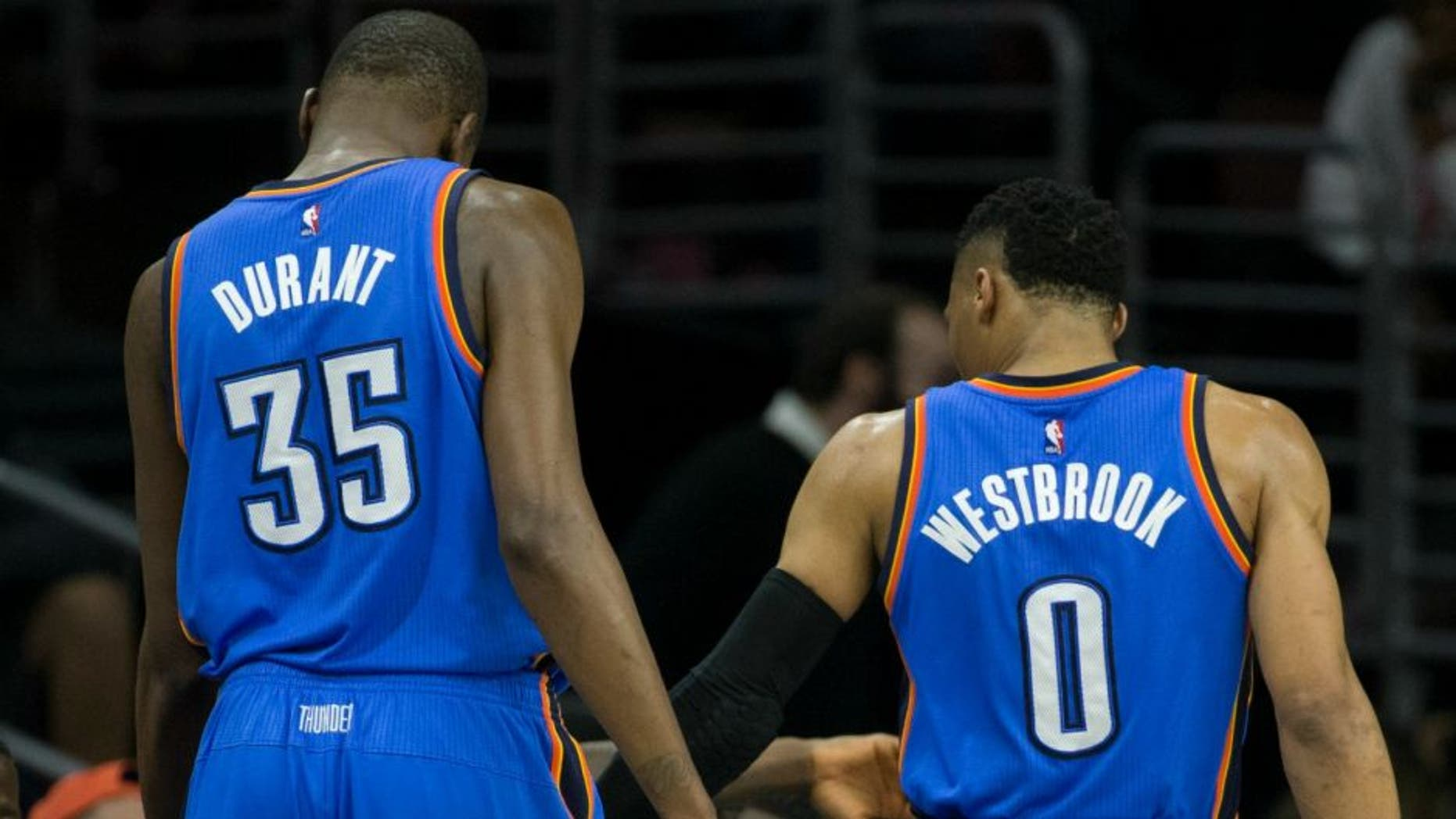 SAN ANTONIO, TX - MAY 10: Russell Westbrook #0 of the Oklahoma City Thunder high fives Kevin Durant #35 during the game against the San Antonio Spurs in Game Five of the Western Conference Semifinals during the 2016 NBA Playoffs on May 10, 2016 at the AT&T Center in San Antonio, Texas. NOTE TO USER: User expressly acknowledges and agrees that, by downloading and or using this photograph, user is consenting to the terms and conditions of the Getty Images License Agreement. Mandatory Copyright Notice: Copyright 2016 NBAE (Photos by Layne Murdoch/NBAE via Getty Images)