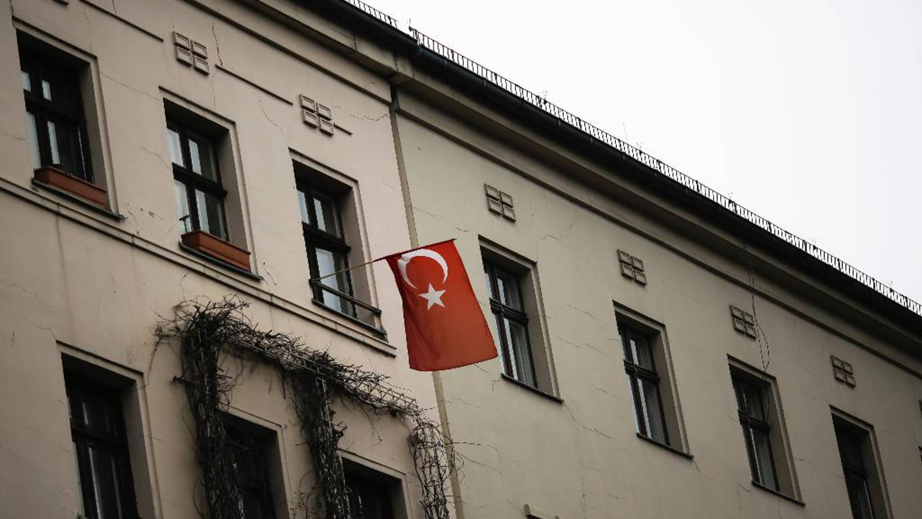 A Turkish national flag is displayed at an apartment building in the district of Kreuzberg in Berlin, Tuesday, March 14, 2017. (AP Photo/Markus Schreiber)