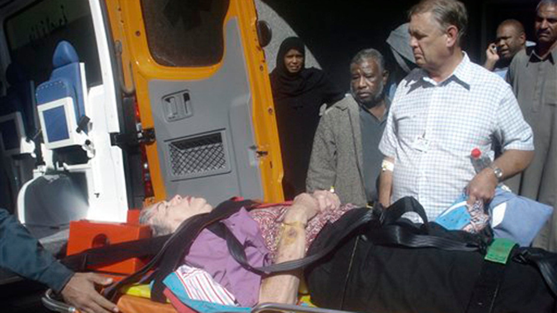 Dec. 26, 2010: An unidentified injured tour bus passenger is moved from an Aswan hospital into an ambulance headed to Aswan airport, to be flown to a hospital in Cairo, after a tour bus crashed into a truck on the 115 mile journey from Aswan to the ancient temples of Abu Simbel, near Aswan in Egypt.