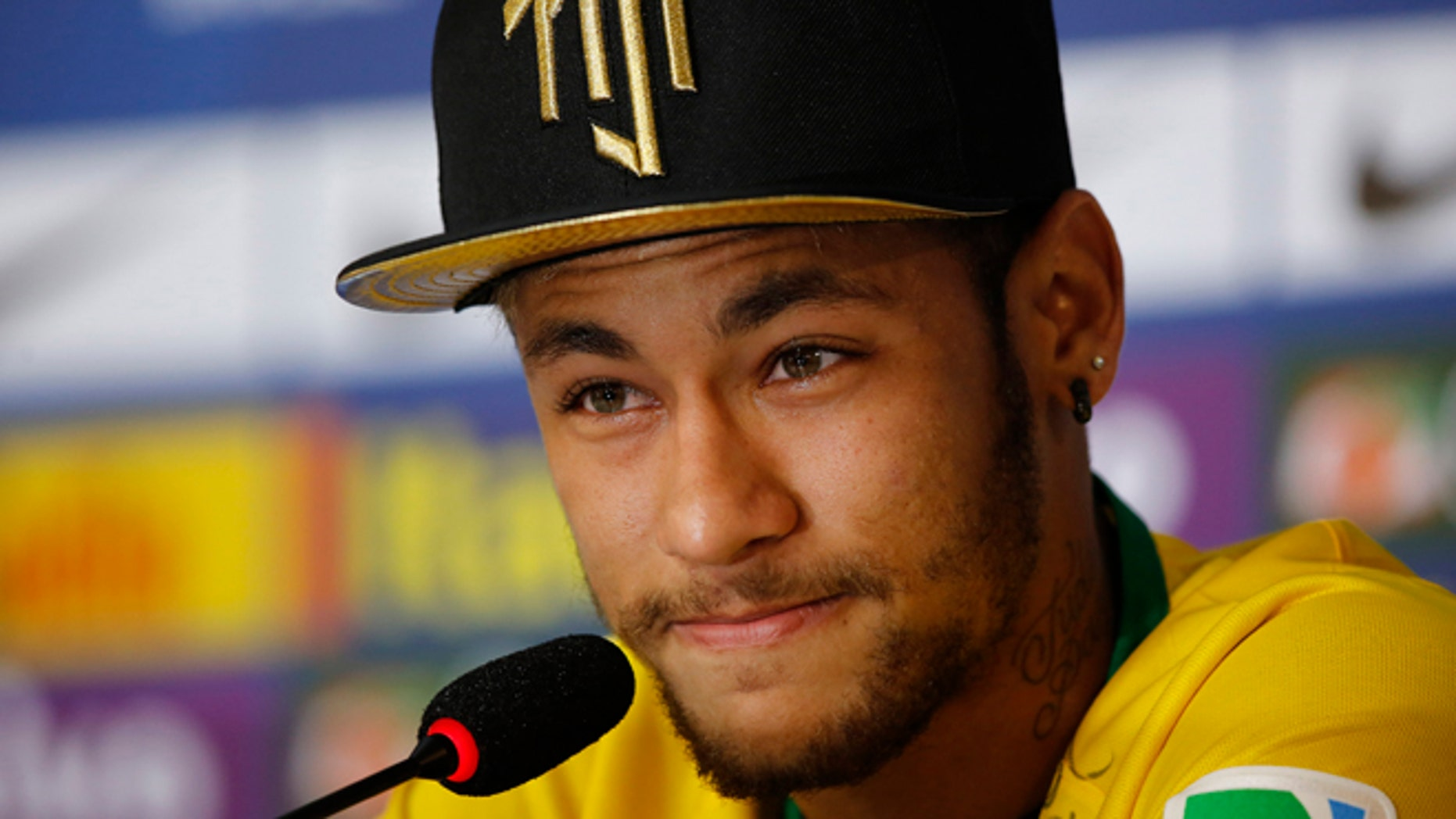 Brazil's Neymar talks to the media a press conference at the Granja Comary training center in Teresopolis, Brazil, Thursday, July 10, 2014. The Brazilian soccer star is back on his feet after suffering a broken vertebrae during a World Cup soccer match against Colombia. Brazil will be disputing a third place finish, without its star on Saturday. (AP Photo/Leo Correa)