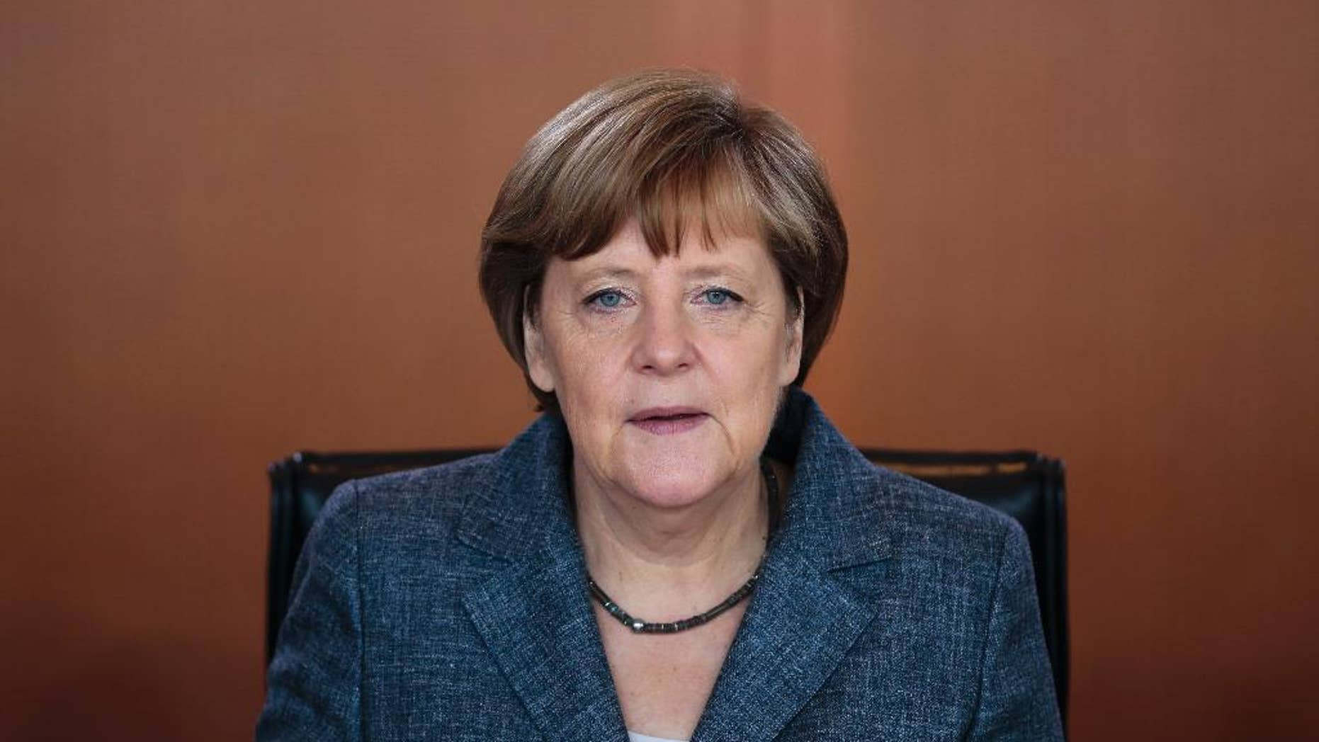 German Chancellor Angela Merkel arrives for the German government's weekly cabinet meeting at the chancellery in Berlin, Germany, Wednesday, June 3, 2015. (AP Photo/Markus Schreiber)