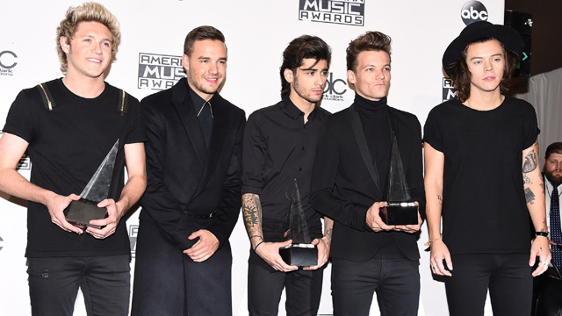 November 23, 2014: Niall Horan, Liam Payne, Zayn Malik, Louis Tomlinson and Harry Styles, of One Direction, pose in the press room with the awards for artist of the year, favorite pop/rock album for 'Midnight Memories' and pop/rock band, duo or group at the 42nd annual American Music Awards at Nokia Theatre L.A. Live in Los Angeles. (Photo by Jordan Strauss/Invision/AP)