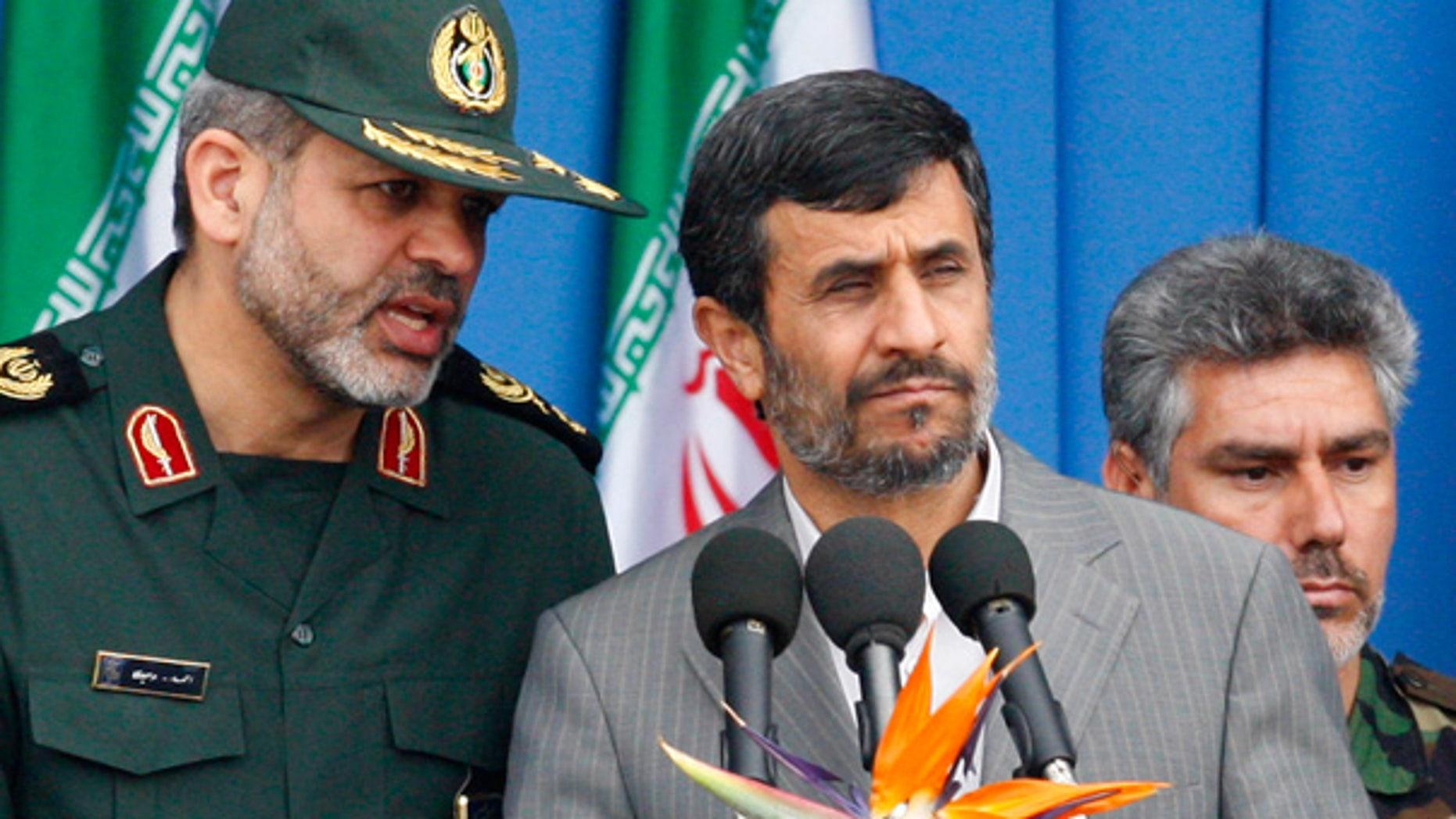 April 18: Iranian President Mahmoud Ahmadinejad listens to his Defense Minister, Gen. Ahmad Vahidi during an army parade in Tehran.