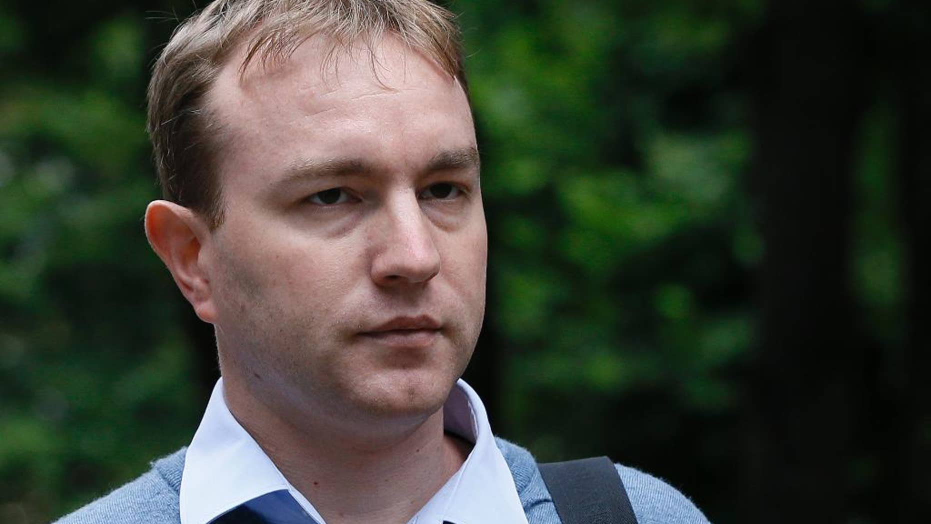 FILE - This is a  Monday, July 27, 2015 file photo of Tom Hayes  as arrives at Southwark Crown Court in London, Monday, July 27, 2015.  A British jury  found  former Citibank and UBS trader Tom Hayes guilty of being the ringmaster in the manipulation of a key interest rate, the London Interbank Lending Rate, or Libor. The jury on Monday Aug. 3, 2015  found 35-year-old Hayes, who specialized in products pegged to yen-denominated Libor, guilty of manipulating the rate from 2006 to 2010. He was charged with conspiring with other traders — but he says he was made a scapegoat for a common practice. (AP Photo/Kirsty Wigglesworth, File)