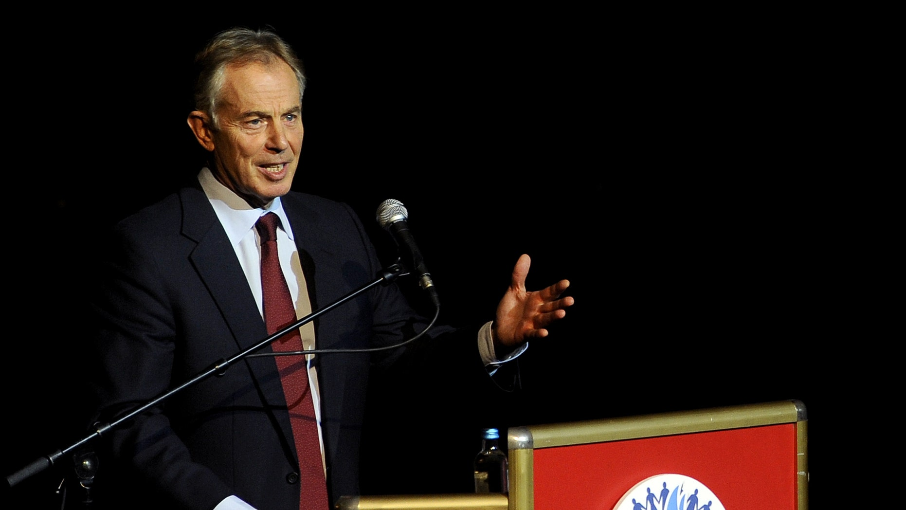 """Former British Prime Minister Tony Blair speaks at the Balkan Peace Festival, organized by the Indian """"Sahara Group"""" in honor of the International Day of Non-Violence, in Skopje, Macedonia, Wednesday, Oct. 2, 2013. (AP Photo/Boris Grdanoski)"""