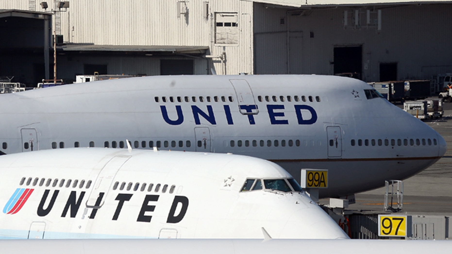 SAN FRANCISCO, CA - JANUARY 23:   United Airlines planes sit on the tarmac at San Francisco International Airport on January 23, 2014 in San Francisco, California. United Airlines parent company United Continental Holdings reported a surge in fourth quarter profits with earnings of $140 million compared to a loss of $620 million one year ago.  (Photo by Justin Sullivan/Getty Images)