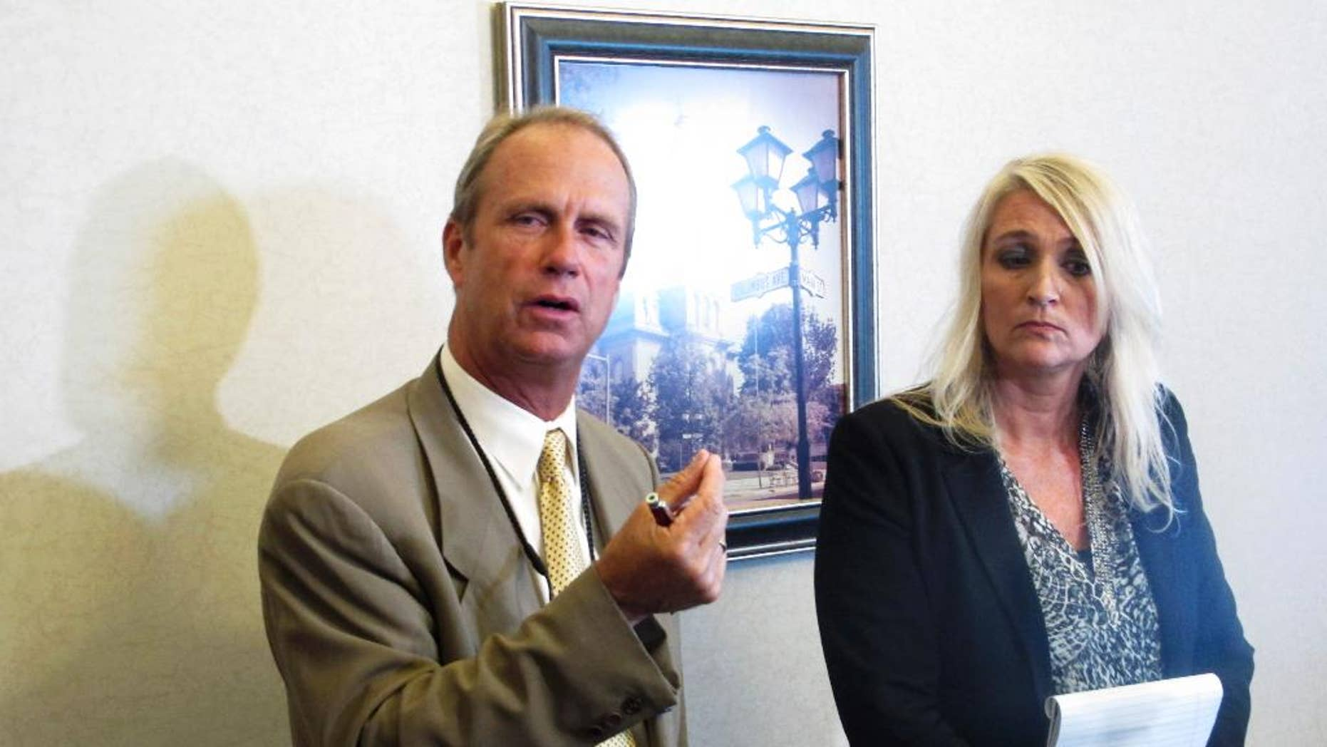 Logan County Prosecutor William Goslee, left, talks about a woman accused of killing her three sons over a 13-month span, alongside Melanie Engle, executive director of Logan County Children's Services, whose agency fought to keep a son who died from being returned home, on Wednesday, Aug. 19, 2015, in Bellefontaine, Ohio. Goslee said the system couldn't have foreseen such erratic behavior by the suspect. (AP Photo/Andrew Welsh-Huggins)