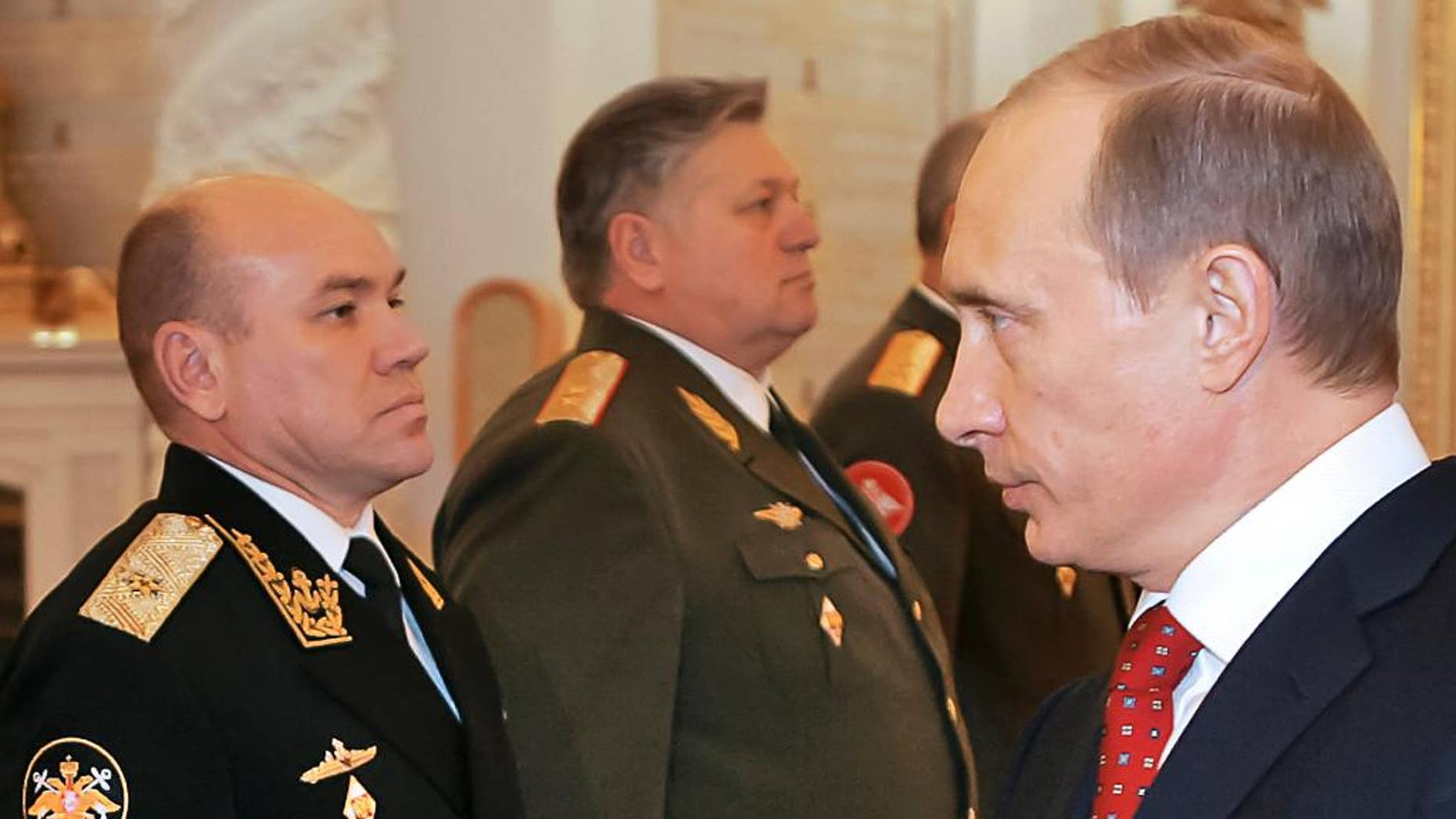 FILE In this file photo taken on Thursday, Feb. 30, 2016, Russian President Vladimir Putin, right, looks at Rear Adm. Viktor Kravchuk, left, during his meeting with a group of top military officers in the Moscow Kremlin, Russia. Russia's defense minister has fired the commander of the Baltic Fleet   Viktor Kravchuk, and his top officers following a sweeping inspection. (Vladimir Rodinov, Sputnik, Kremlin Pool Photo via AP, file)
