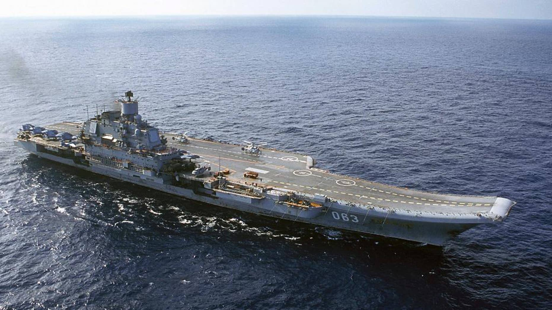 FILE - In this 2004 file photo the Admiral Kuznetsov carrier seen in the Barents Sea, Russia. Russian Defense Minister Sergei Shoigu said Wednesday, Sept. 21, 2016, that the navy will send its only aircraft carrier, the Admiral Kuznetsov, to the eastern Mediterranean to join other Russian ships deployed near the Syrian shores.(AP Photo, file)
