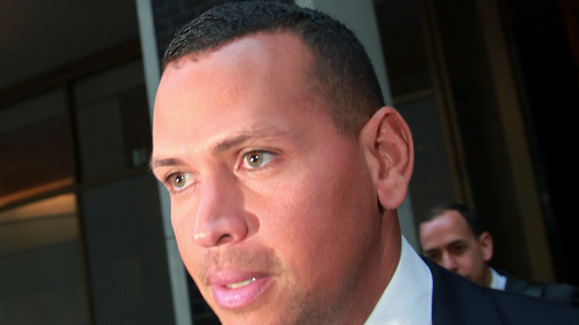 FILE- In this Sept. 30, 2013 file photo, Alex Rodriguez leaves the offices of Major League Baseball in New York. Rodriguez has accepted his season-long suspension from Major League Baseball, the longest penalty in the sport's history related to performance-enhancing drugs. Rodriguez withdrew his lawsuits against Major League Baseball, Commissioner Bud Selig and the players' association to overturn his season-long suspension on Friday, Feb. 7, 2014. The notices of dismissal were filed in federal court in Manhattan. (AP Photo/David Karp, File)