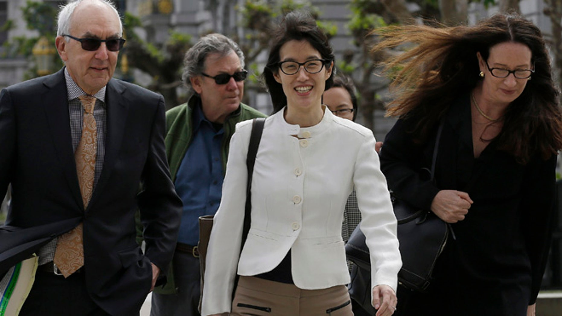 Mar. 17, 2015: Ellen Pao, center, walks to Civic Center Courthouse in San Francisco (AP)