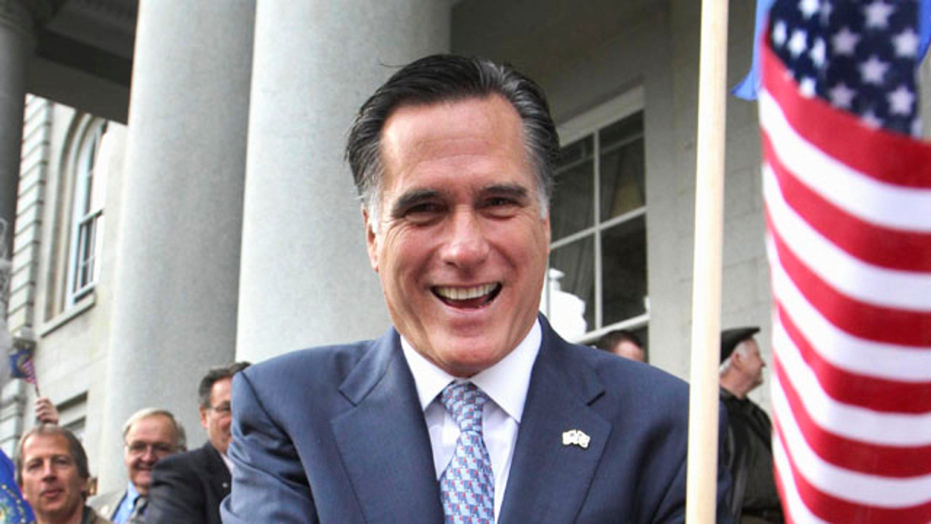 FILE - In this Oct. 24, 2011 file photo, Republican presidential candidate, former Massachusetts Gov. Mitt Romney greets supporters outside the State House  in Concord, N.H. (AP Photo/Jim Cole, File)
