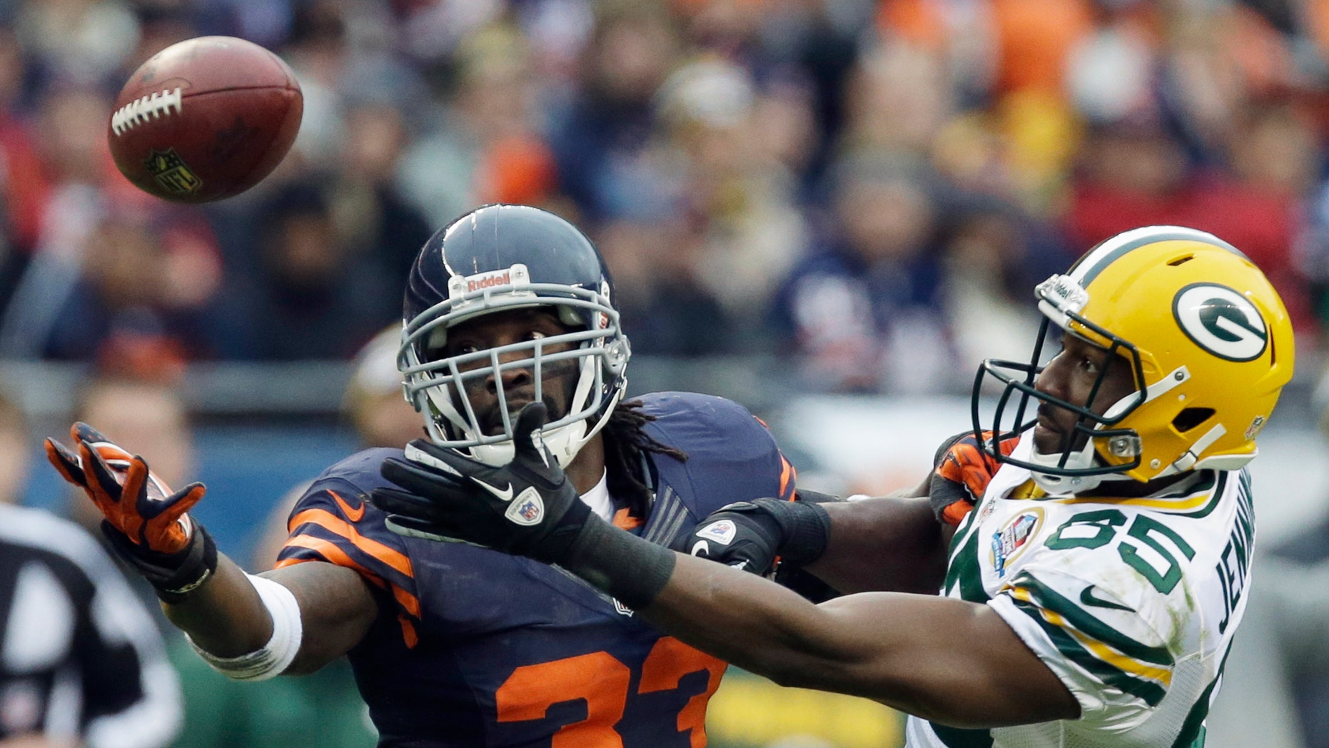 Chicago Bears cornerback Charles Tillman (33) breaks up a pass intended for Green Bay Packers wide receiver Greg Jennings (85) in the second half of an NFL football game in Chicago, Sunday, Dec. 16, 2012. The Packers won 21-13 to clinch the NFC North division title. (AP Photo/Nam Y. Huh)