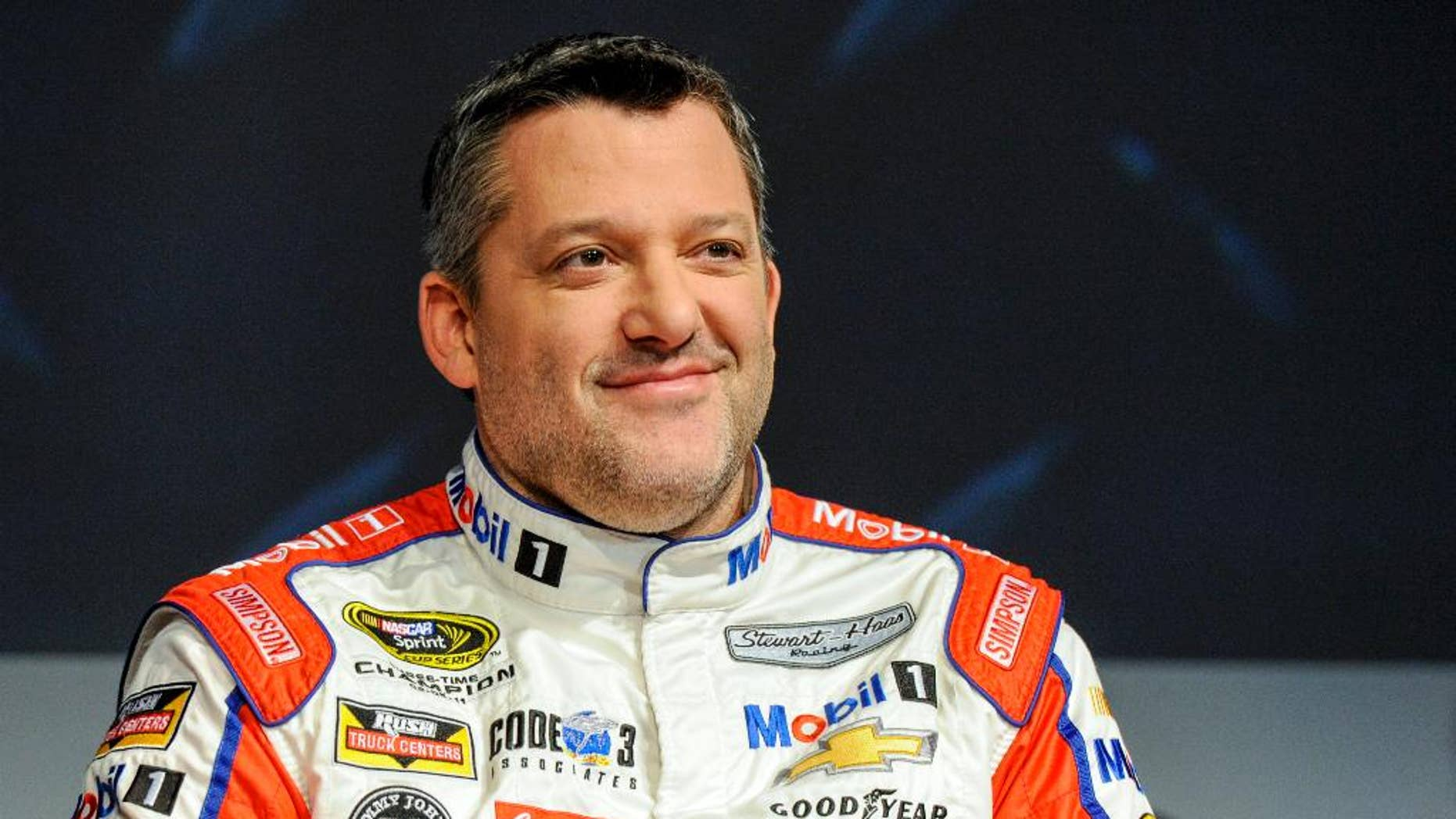 FILE - In this Thursay, Jan. 21, 2016, file photo, Stewart Haas Racing co-owner and driver Tony Stewart talks to members of the media during the NASCAR Charlotte Motor Speedway Media Tour in Charlotte, N.C. Stewart suffered his first serious hit since his return from a back injury during a three-car wreck at practice at Dover International Speedway, Friday, May 13, 2016. (AP Photo/Mike McCarn, File)
