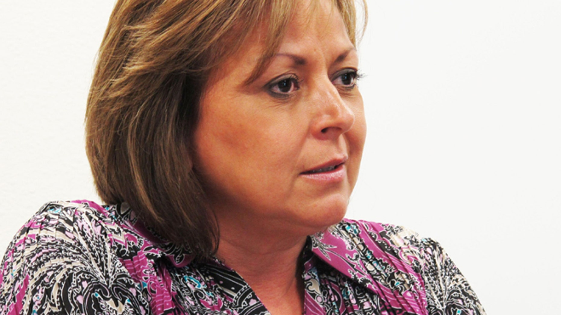 New Mexico Gov. Susana Martinez talks about being tapped to speak at the Republican National Convention following a news conference Monday, Aug. 6, 2012, on her action to eliminate registration fees for companies doing business in New Mexico. Martinez says the announcement puts to rest months-long rumors she was a potential running mate for Mitt Romney. (AP Photo/Jeri Clausing)