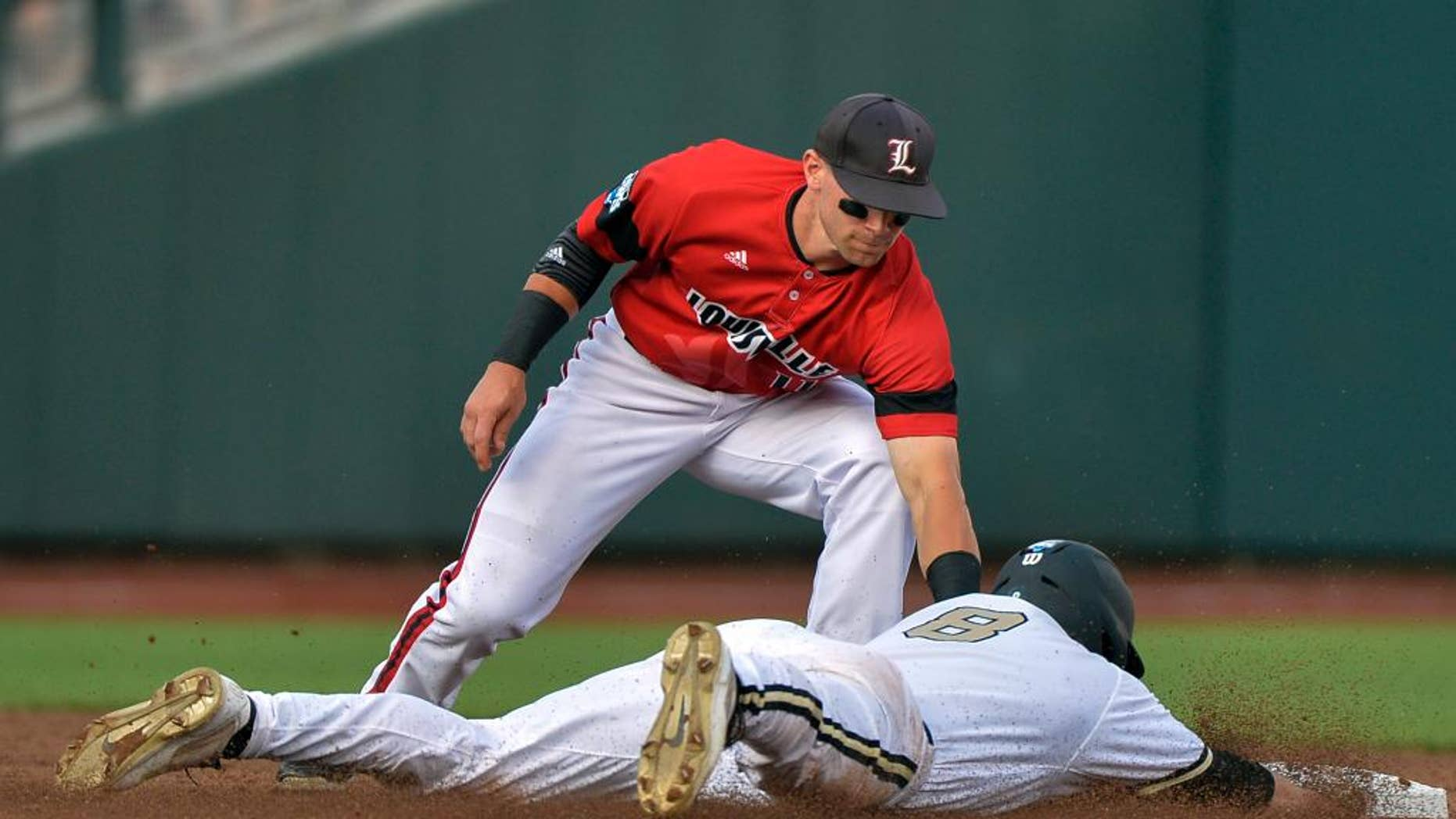 Vanderbilt's Rhett Wiseman (8) is caught stealing second base by Louisville second baseman Zach Lucas, top, in the second inning of an NCAA baseball College World Series game in Omaha, Neb., Saturday, June 14, 2014. (AP Photo/Ted Kirk)