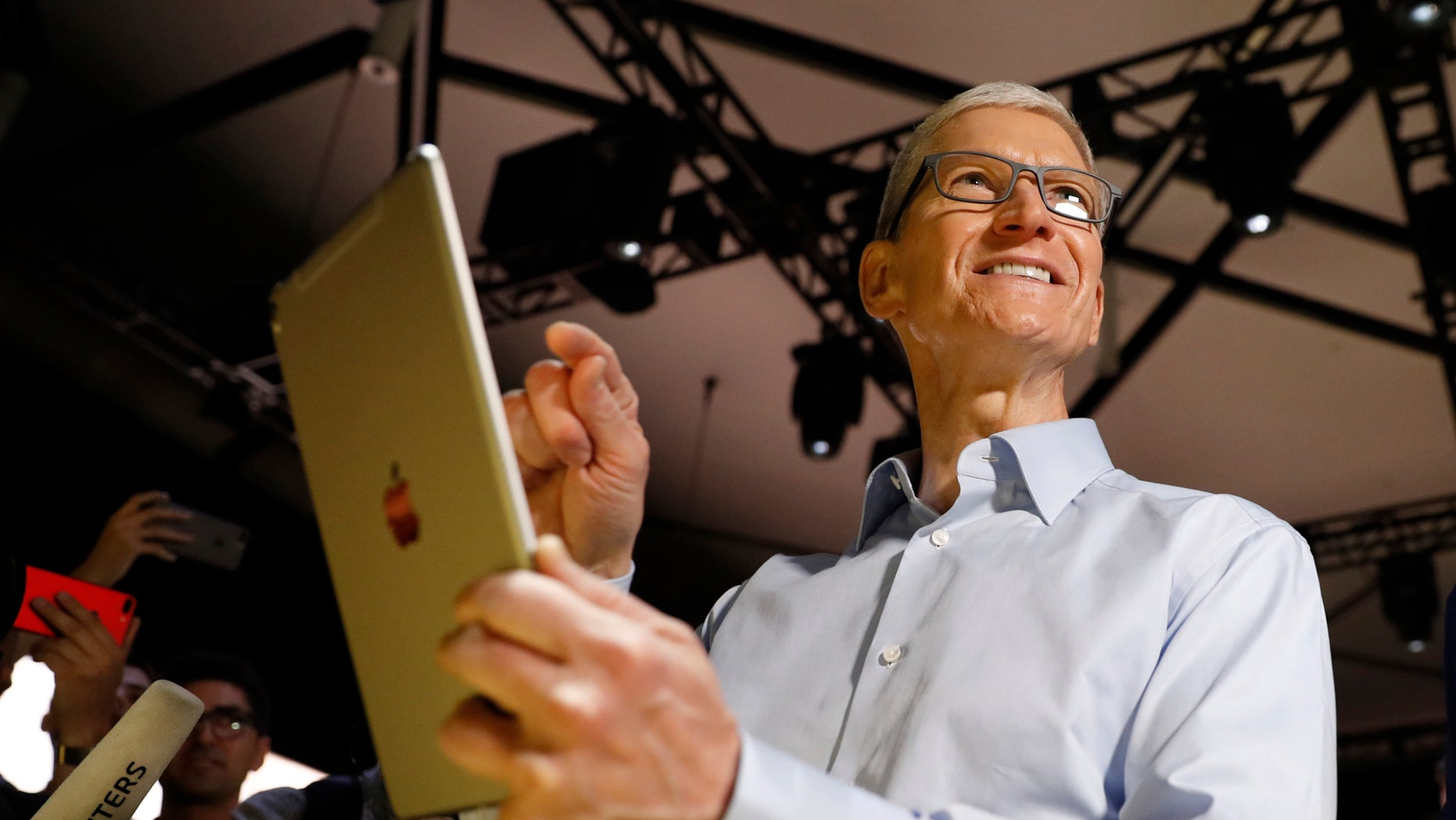 File photo: Tim Cook, CEO, holds an iPad Pro after his keynote address to Apple's annual world wide developer conference (WWDC) in San Jose, California, U.S. June 5, 2017. (REUTERS/Stephen Lam)