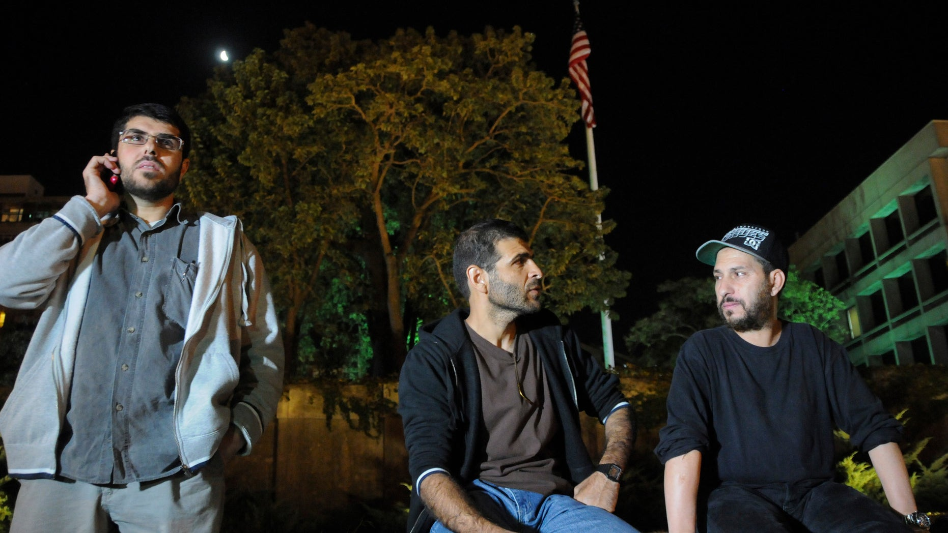 Three freed Guantanamo detainees during protest outside the U.S. embassy in Montevideo, in April 2015.