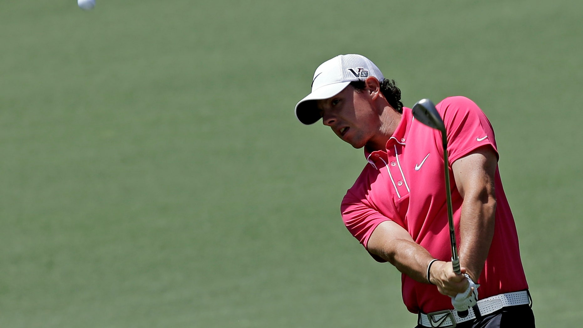 Rory McIlroy, of Northern Ireland, chips to the second green during the third round of the Masters golf tournament Saturday, April 13, 2013, in Augusta, Ga. (AP Photo/David J. Phillip)