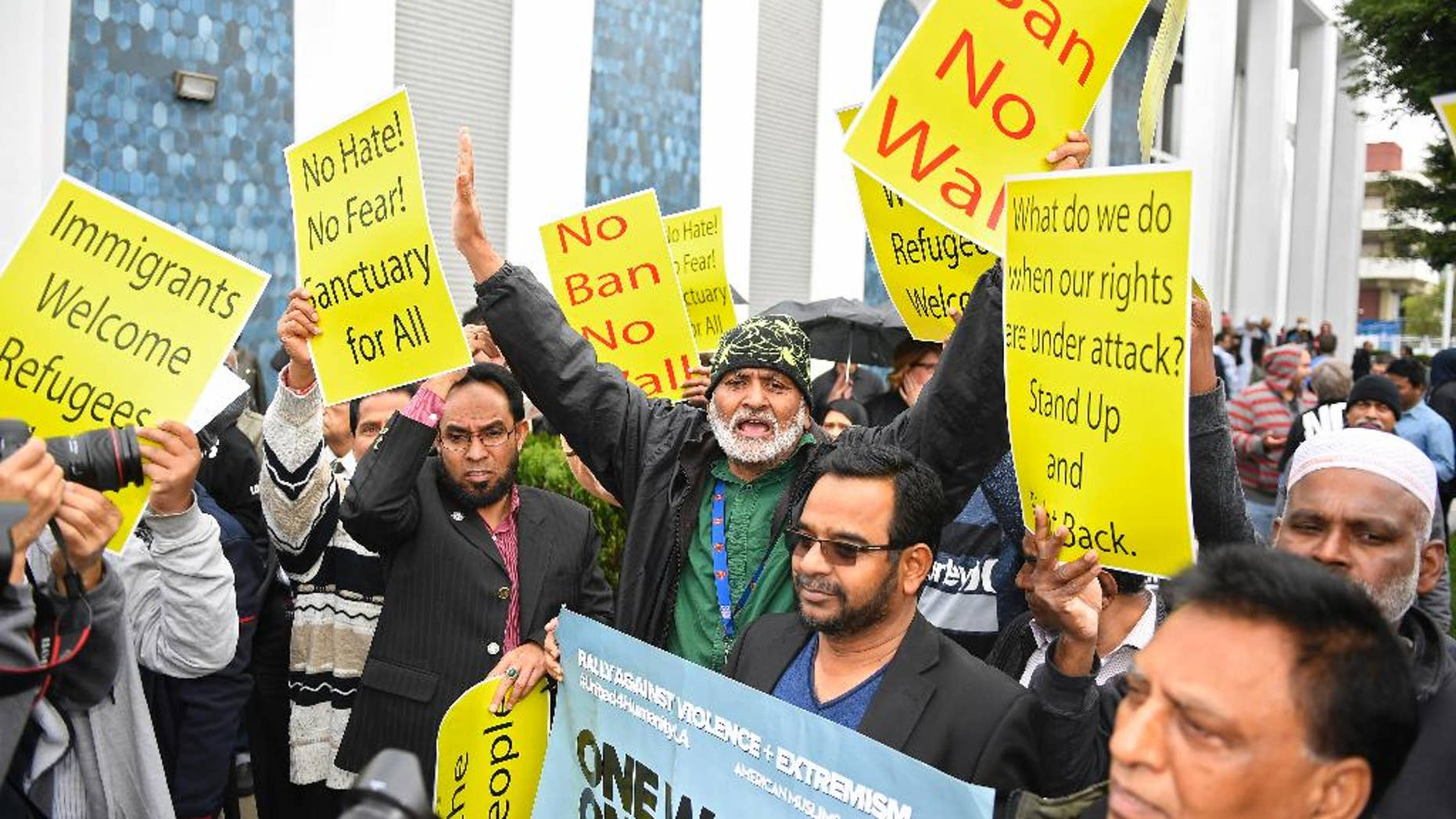 Supporters chant during a rally where civil rights, faith groups, labor, and community advocates and leaders gathered at the Islamic Center of Southern California as part of a nationwide day of unity, Friday, Feb. 3, 2017, in Los Angeles, to respond to President Trump's slew of executive orders targeting refugees and immigrants. The show of support and news conference was put on by the Coalition for Humane Immigrant Rights. (AP Photo/Mark J. Terrill)