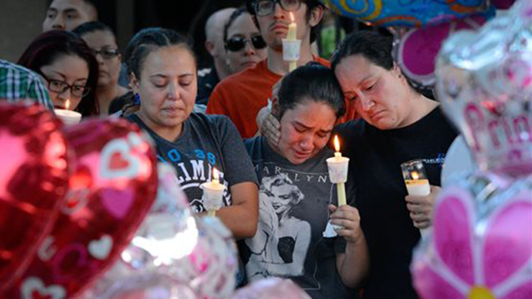 A candlelight vigil for 10-year-old Victoria Martens on Aug. 25, 2016, in Albuquerque, N.M.