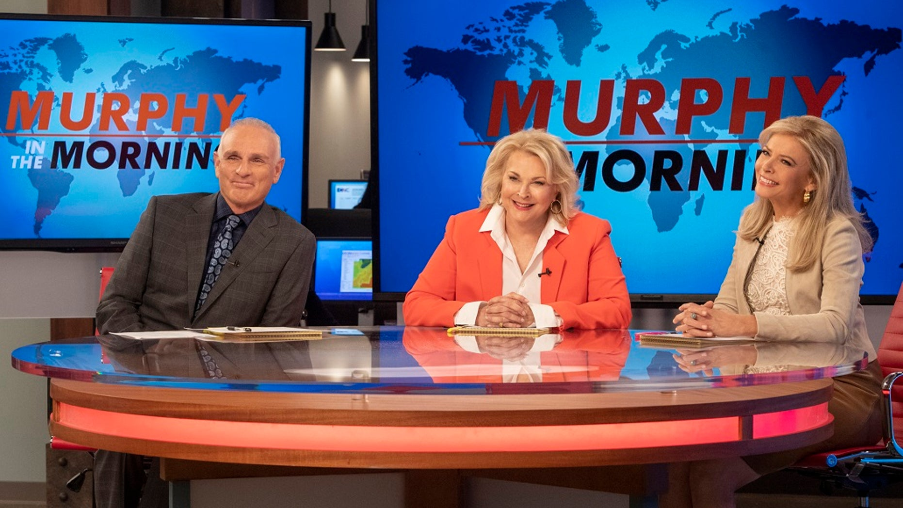 """This image released by CBS shows Joe Regalbuto, Candice Bergen and Faith Ford from the comedy series, """"Murphy Brown."""" Political, social issues and the role of journalism will be central when the sitcom, starring  Bergen as a skeptical TV reporter, returns Thursday on CBS. (David Giesbrecht/Warner Bros. via AP)"""