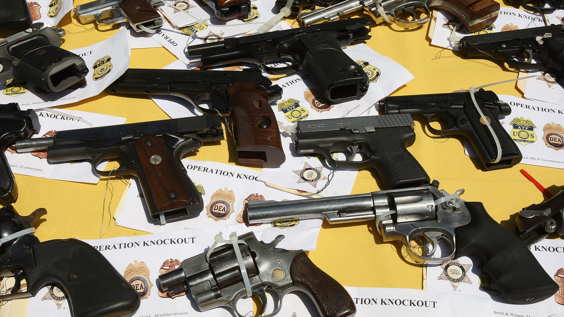 LAKEWOOD, CA - MAY 21:  Some of about 125 weapons confiscated during what the federal authorities say is the largest gang takedown in United States history are displayed at a press conference to announce the arrests of scores of alleged gang members and associates on federal racketeering and drug-trafficking charges on May 21, 2009 in the Los Angeles-area community of Lakewood, California. 147 people were indicted in the case involving racially motivated attacks on African-Americans and law enforcement officers. Operation Knockout is the latest of several investigations that found gangs engaged in race-based violence. Two years ago, a Latino gang was charged with waging a violent campaign to drive blacks out of a Los Angeles-area neighborhood that resulted in 20 homicides. Last year, another Latino gang was accused of targeting blacks and killing 14-year-old Cheryl Green, whose death became a community rallying point. In 2006, Avenues gang members Latinos were convicted of assaults and killings of blacks in the 1990s.  (Photo by David McNew/Getty Images)