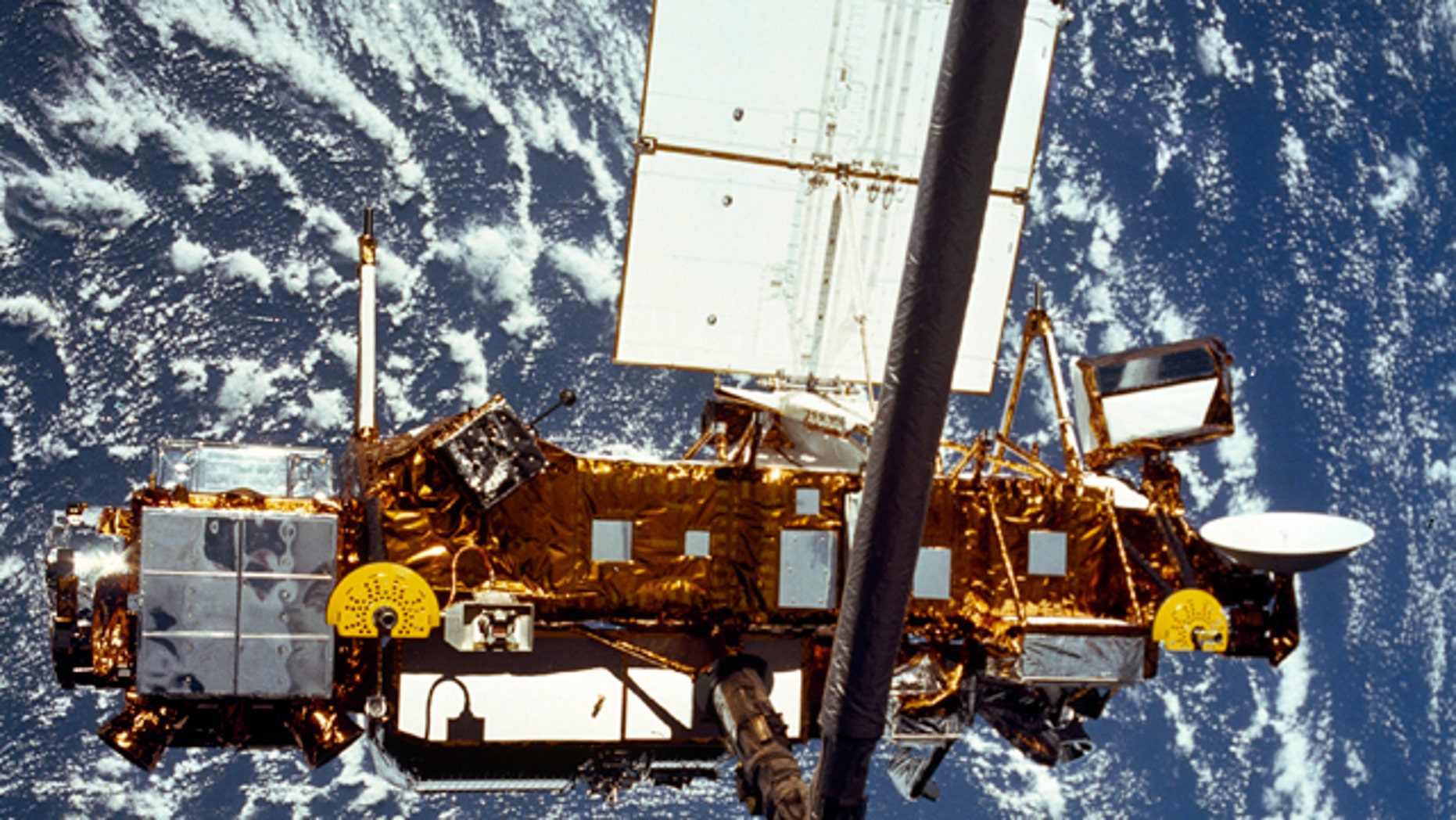 The Upper Atmosphere Research Satellite (UARS) is seen in the grasp of a robotic arm during deployment from the space shuttle in September, 1991. NASA's old research satellite came crashing down through the atmosphere Saturday, Sept. 24, 2011 -- though where exactly may never be known.