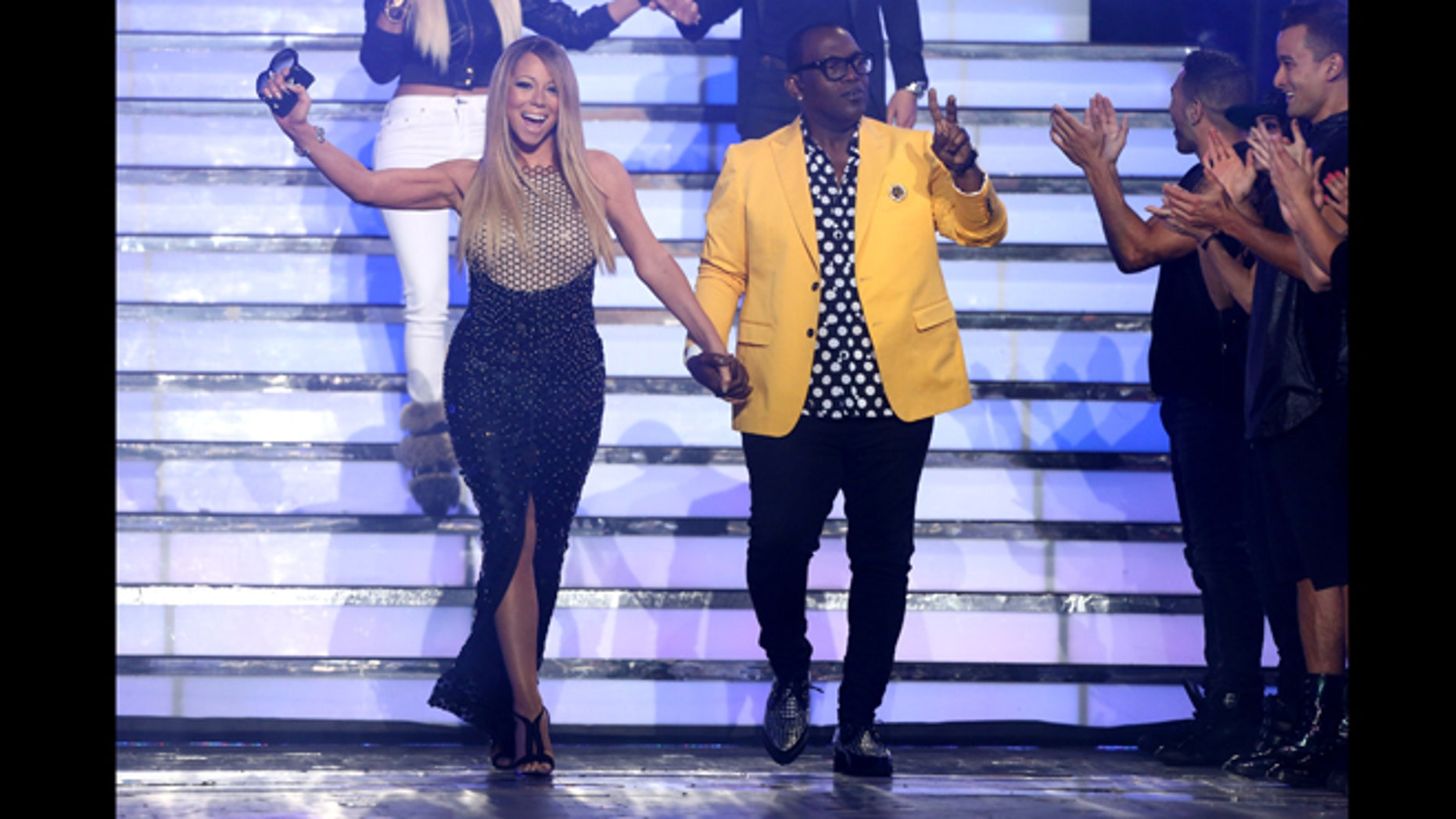 """May 16, 2013: Judges Mariah Carey, left, and Randy Jackson walk on stage at the """"American Idol"""" finale at the Nokia Theatre at L.A. Live in Los Angeles."""